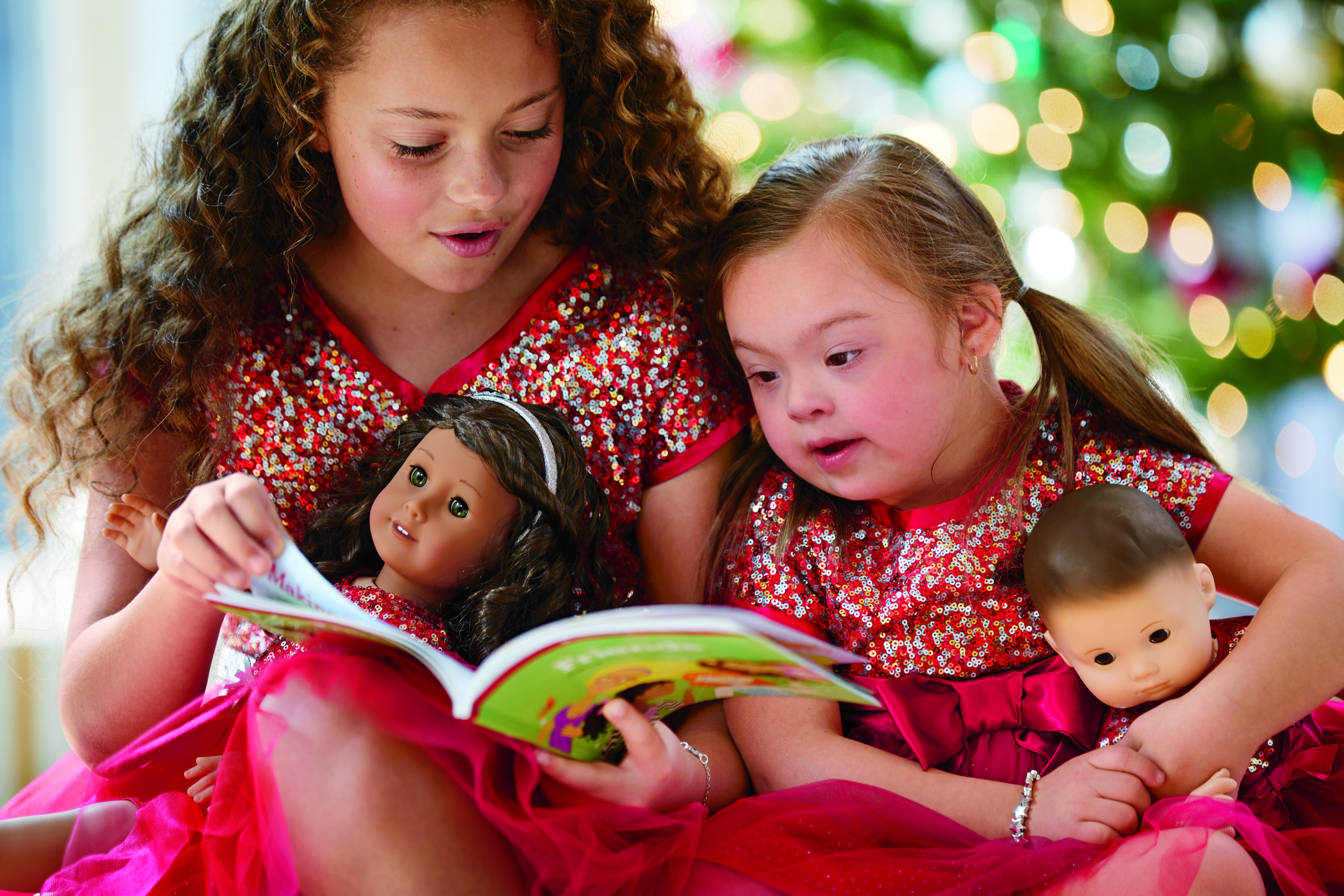 Four-year-old Ivy Kimble (right) is featured in the 2019 American Girl October holiday catalog.