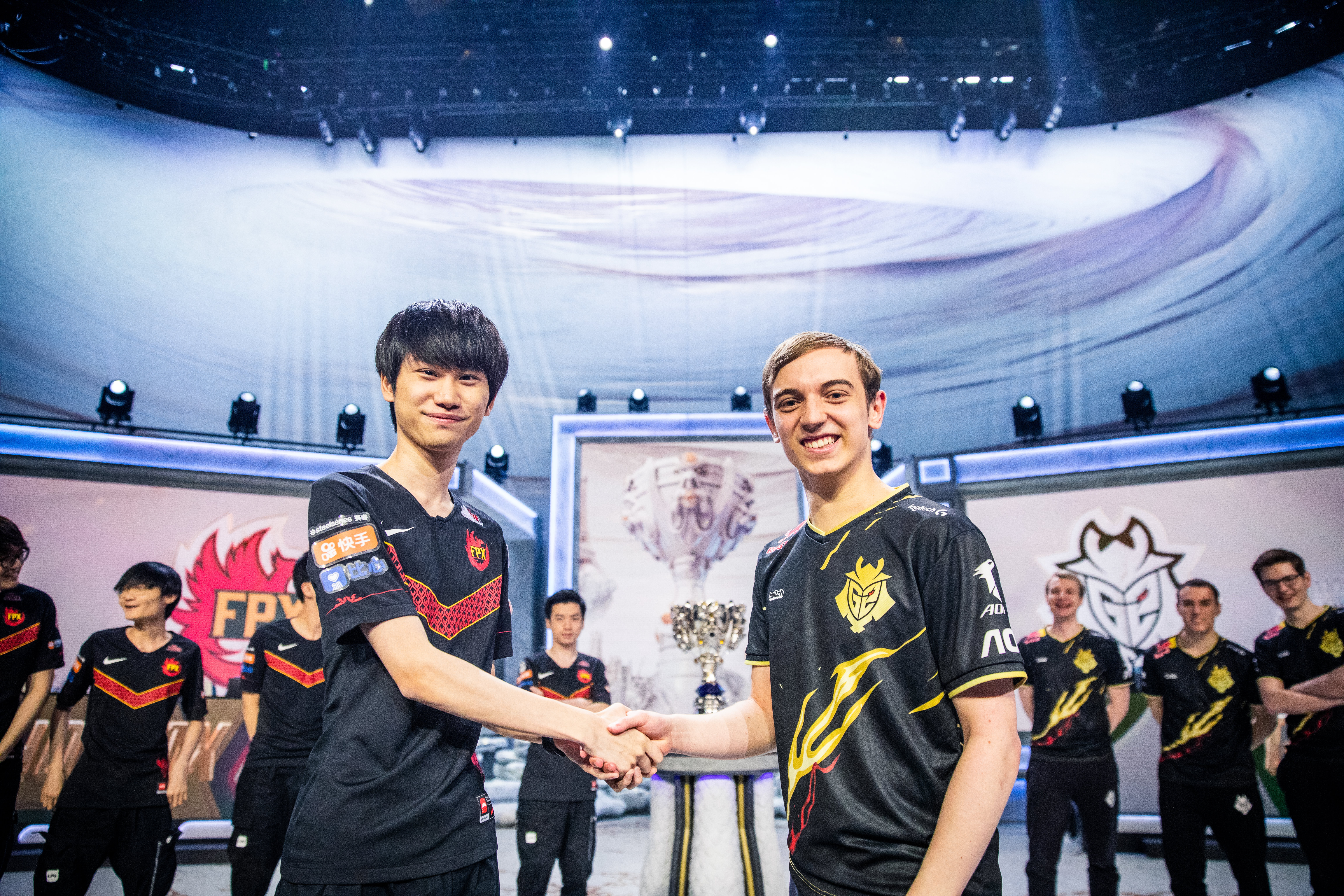 The FunPlus Phoenix and G2 Esports team captains shake hands