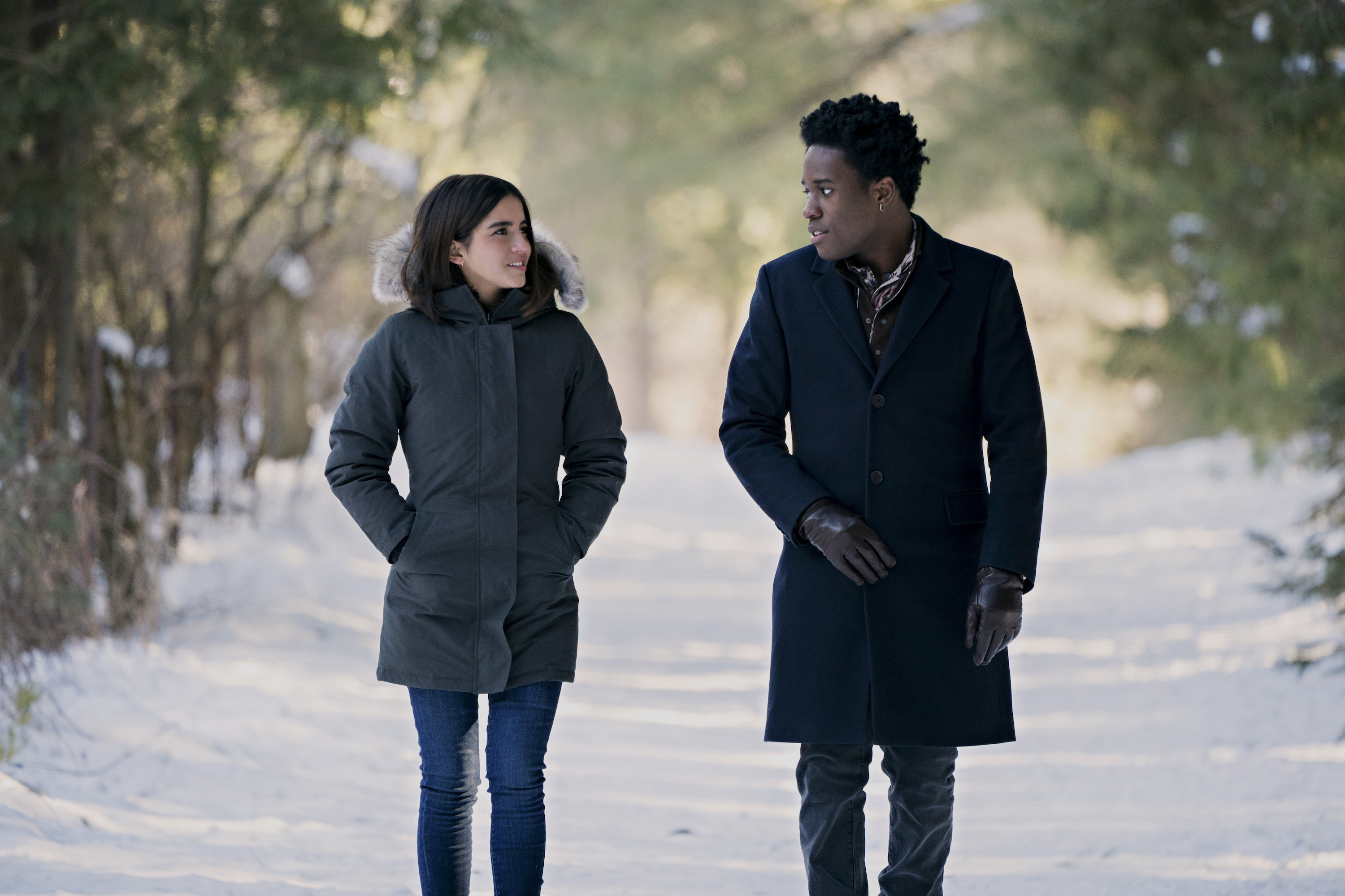 Julie (Merced) and Stuart (Moore) take a walk in the snow.