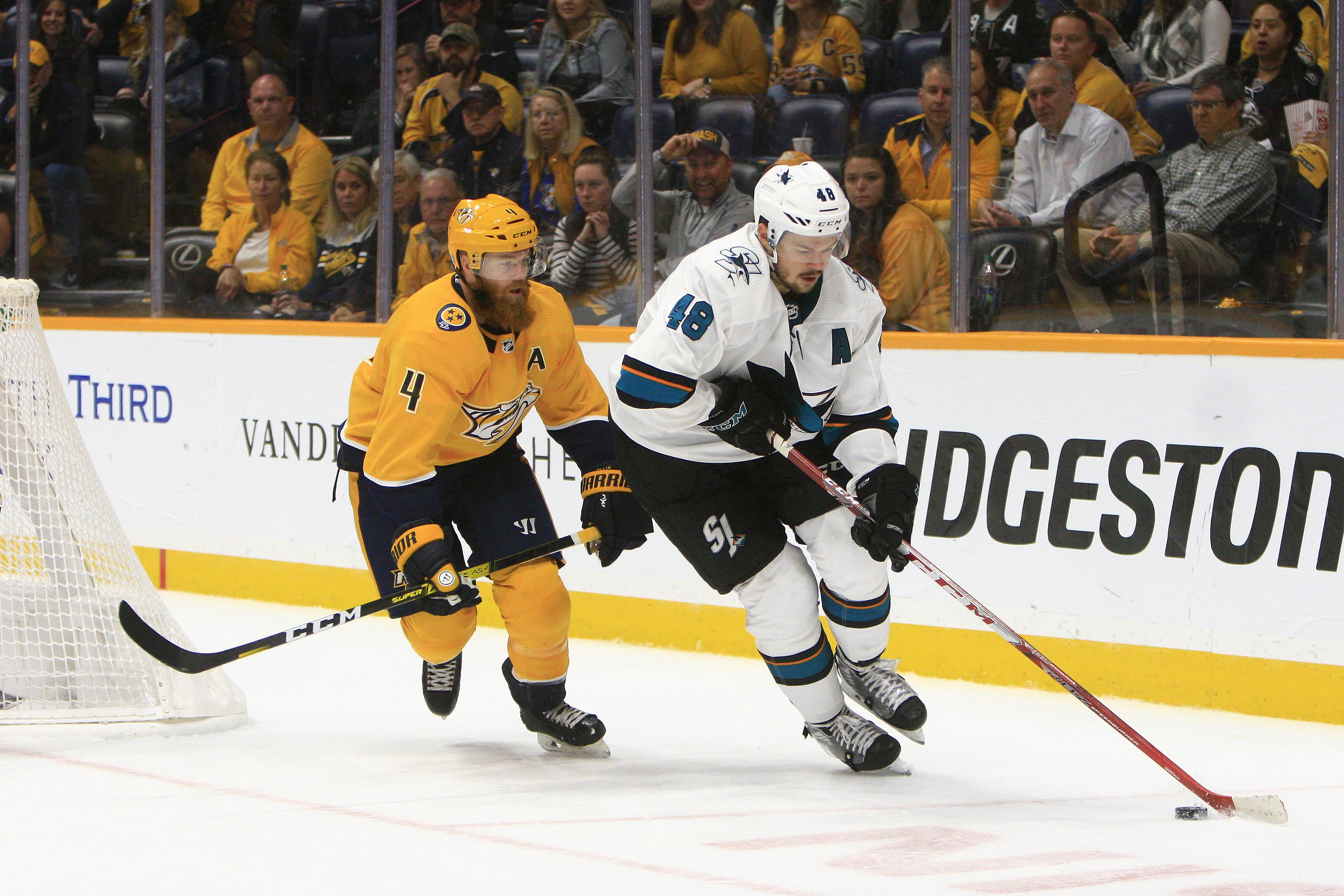 Nashville Predators defenseman Ryan Ellis (4) defends against San Jose Sharks center Tomas Hertl (48) during the NHL game between the Nashville Predators and San Jose Sharks, held on October 8, 2019, at Bridgestone Arena in Nashville, Tennessee.
