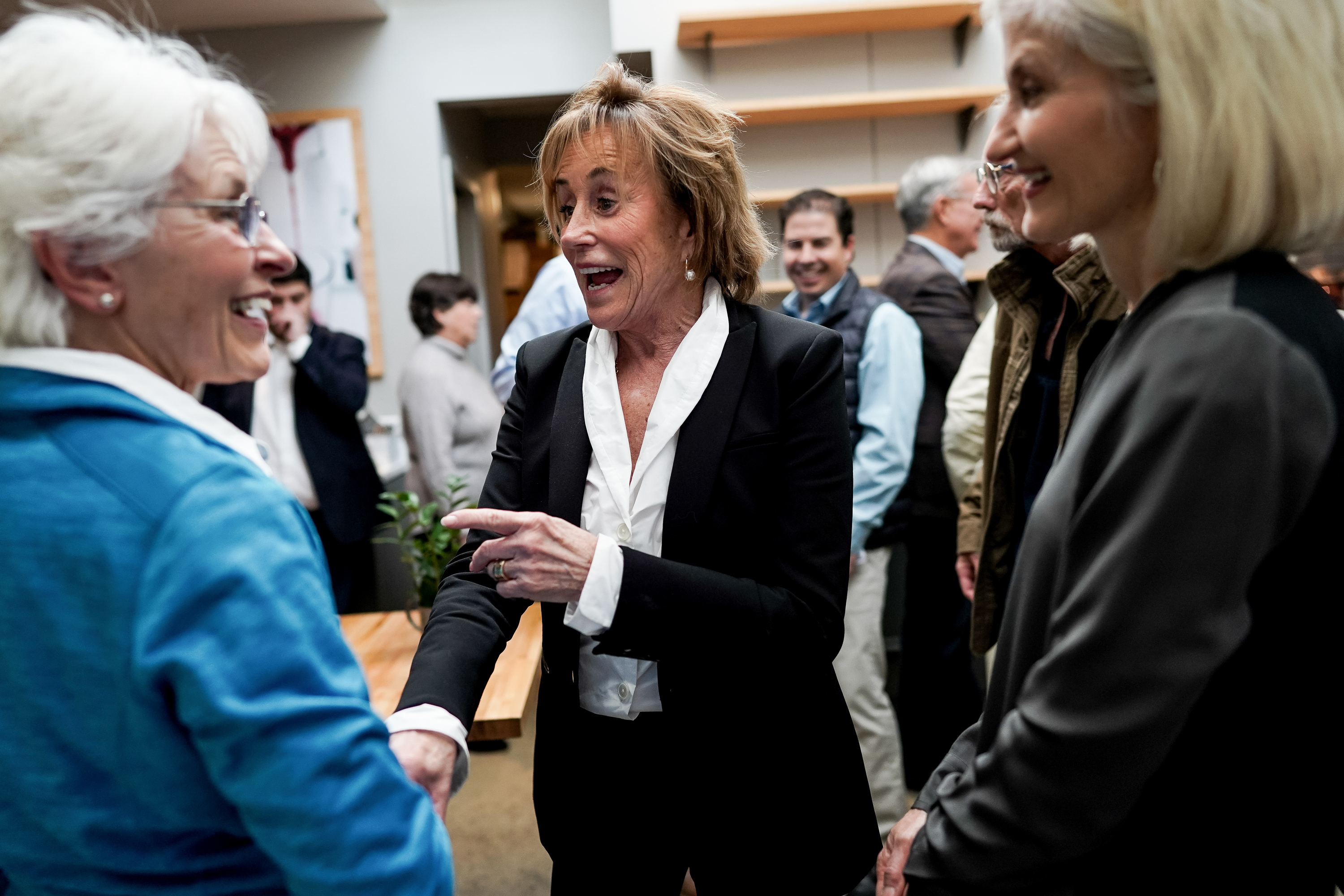 Valerie Biden Owens, center, chats with Jill Lesh, left, and Cynthia Owens, right, as Biden Owens campaigns for her brother, former vice president and Democratic presidential contender Joe Biden, at Pulp Lifestyle Kitchen in Salt Lake City on Saturday, Nov. 9, 2019.