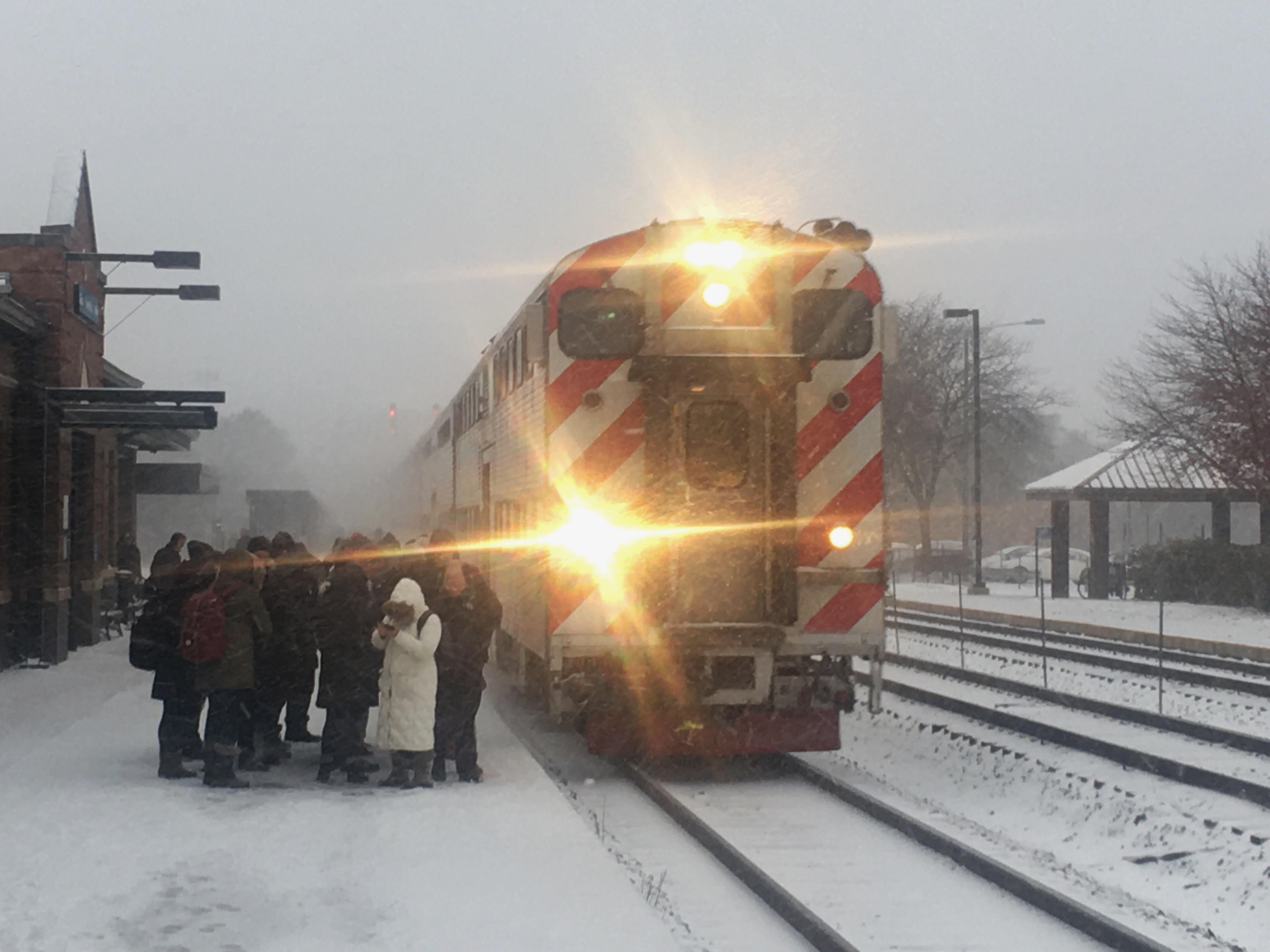 Temperatures will plummet as low as 12 degrees Nov. 12, 2019, the National Weather Service said. Commuters bundle up at a Metra station in Naperville.