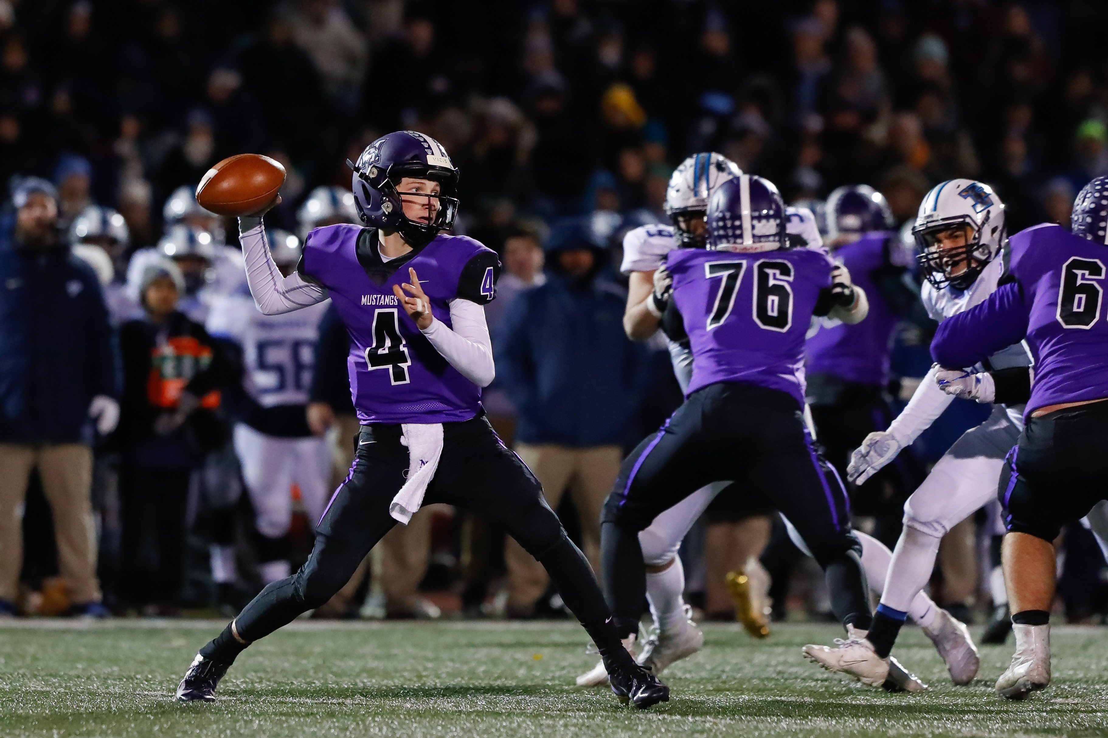 Rolling Meadows' Carson Schiller (4) looks for an open receiver against Prospect.