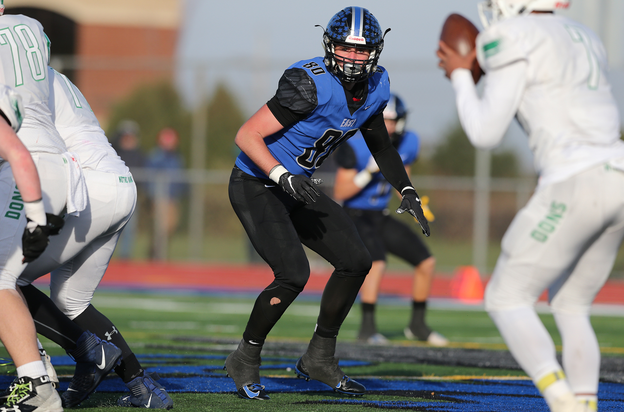Lincoln-Way East's Sean McLaughlin (80) rushes Notre Dame's quarterback.