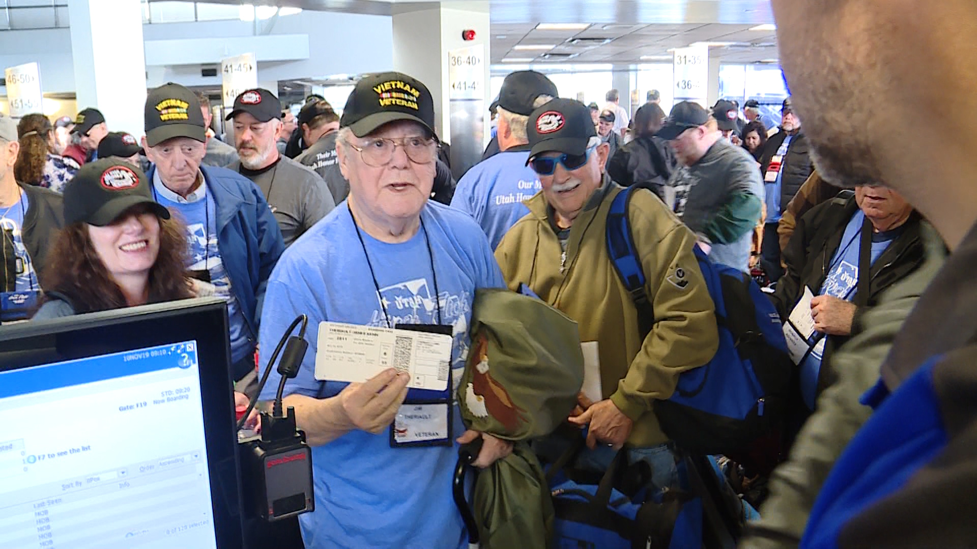 Veterans make their way to the gate to board an Honor Flight to Washington Sunday in Salt Lake City.