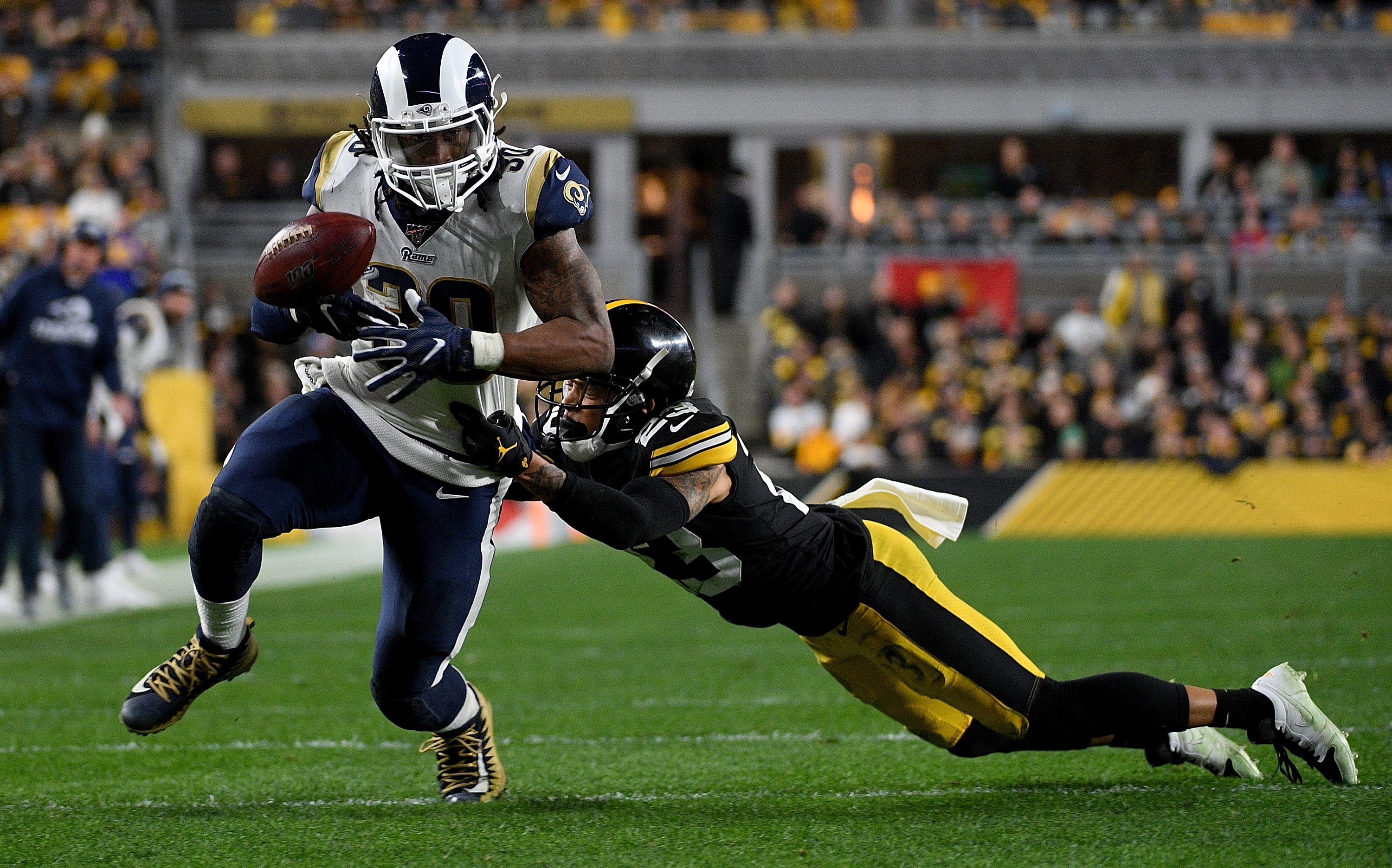 Los Angeles Rams RB Todd Gurley loses the ball as  Pittsburgh Steelers DB Joe Haden attempts to bring him down in Week 10, Nov. 10, 2019.