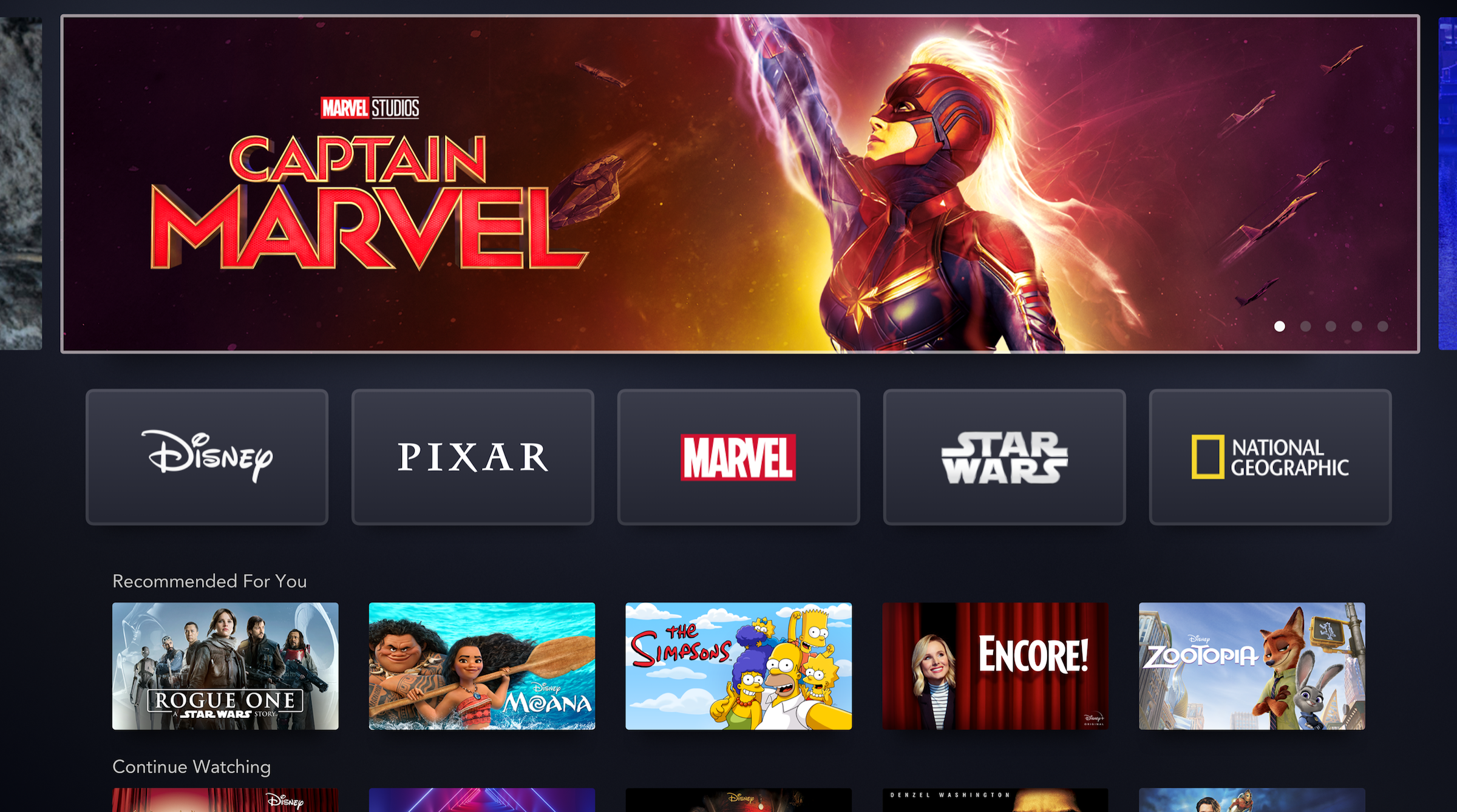 disney plus homepage featuring captain marvel, moana, simpsons, rogue one, and zootopia