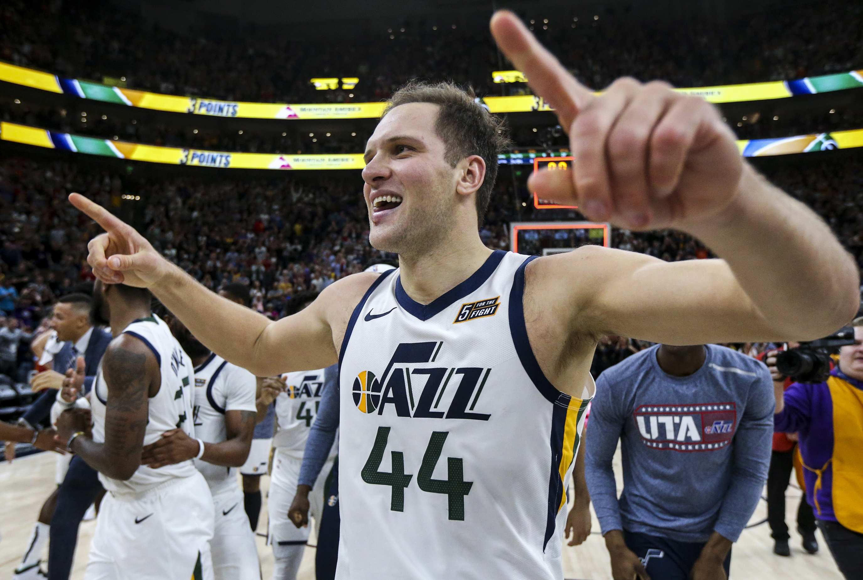 Utah Jazz forward Bojan Bogdanovic (44) and the rest of the team celebrate after Bogdanovic scored the game-winning basket in the final second of regulation play in the second half of an NBA basketball game at Vivint Arena in Salt Lake City on Friday, Nov. 8, 2019.