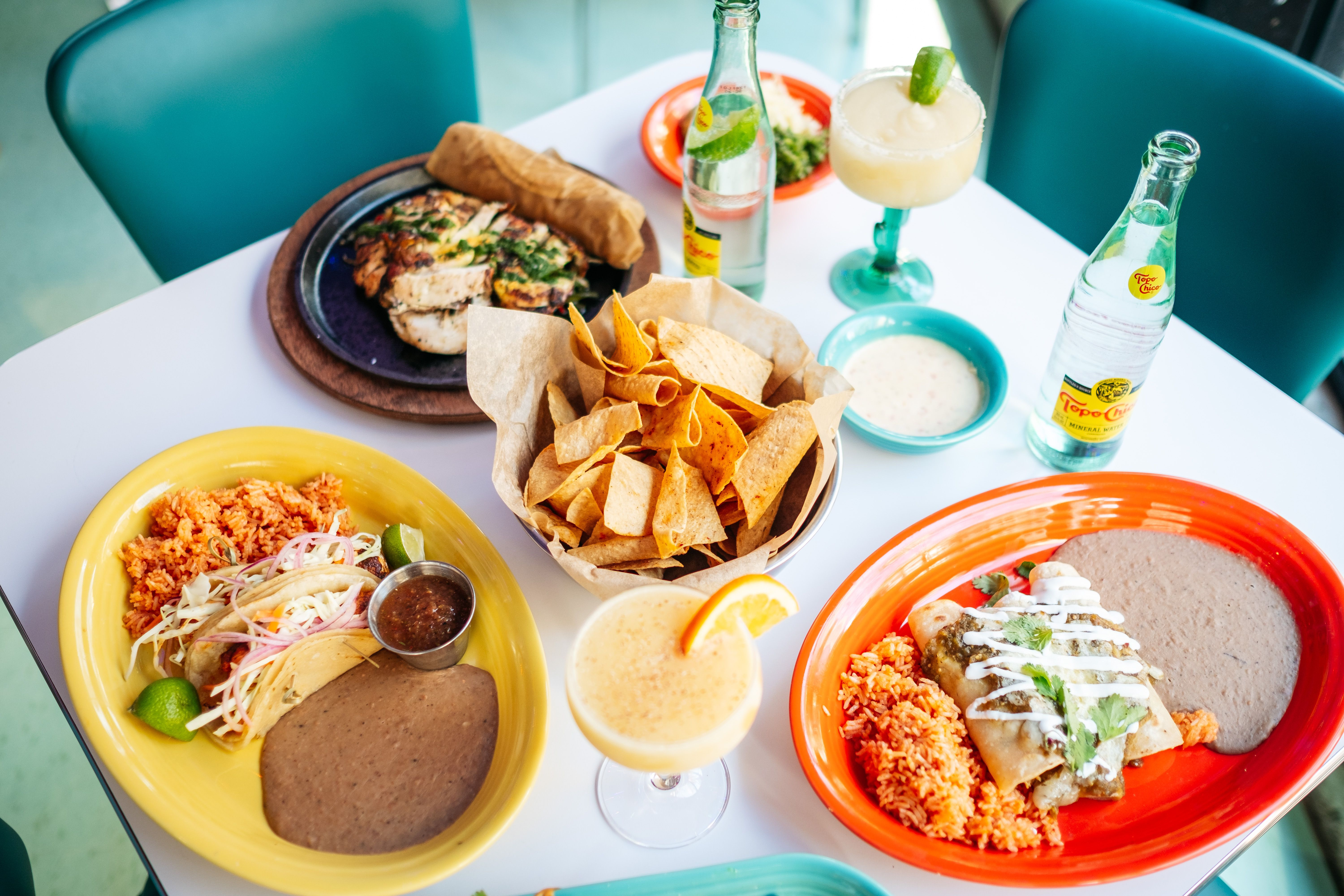 grilled fish tacos, tortilla chips, margarita, and flautas at Queso Beso