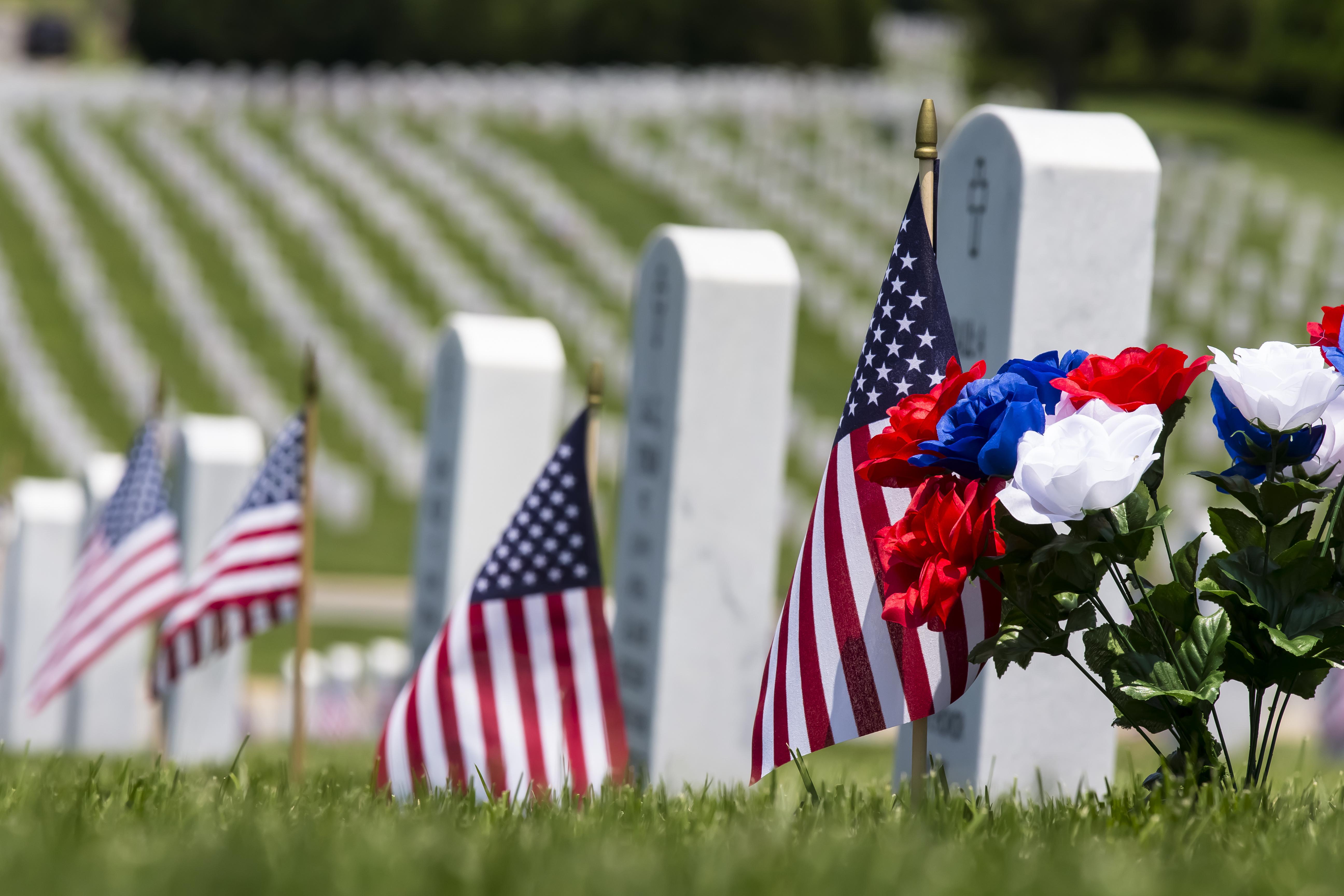 American flags decorate veterans' graves for Memorial Day.
