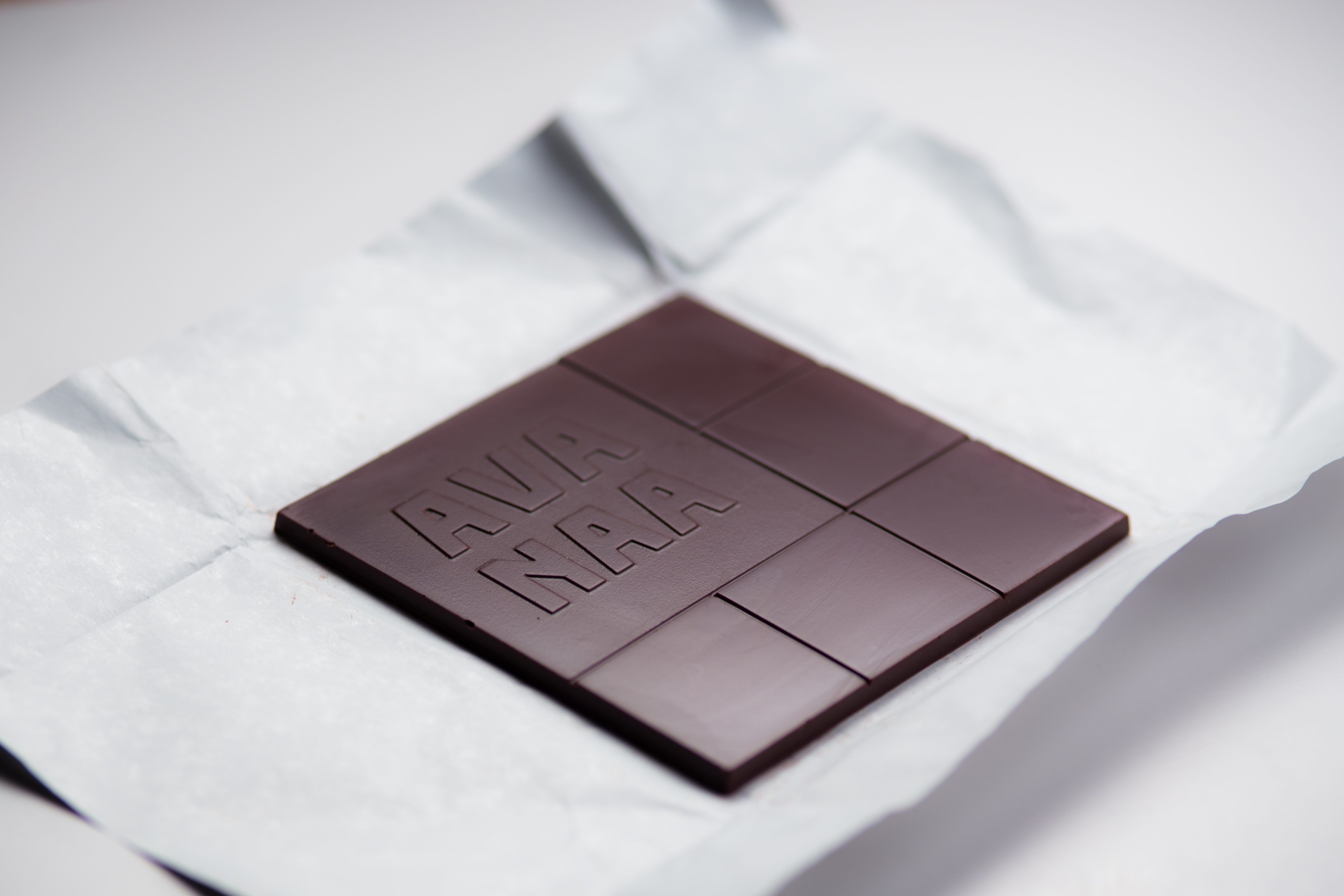 A chocolate square on white paper.