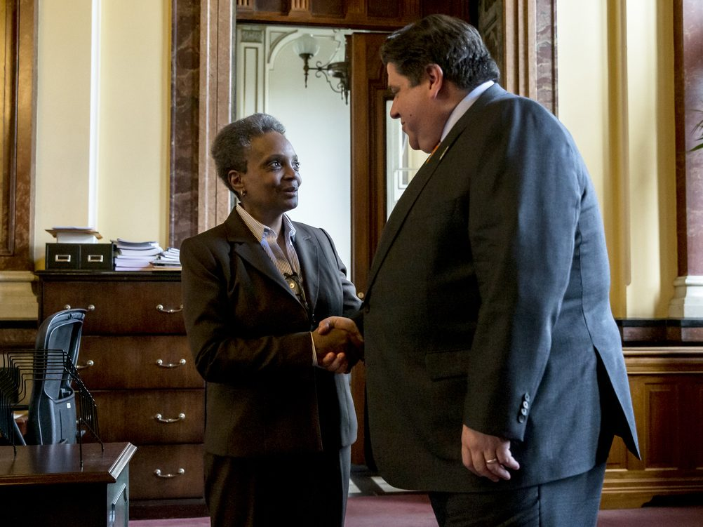 Mayor-elect Lori Lightfoot shakes hands with Gov. J.B. Pritzker after a meeting in his offices at the Illinois State Capitol in Springfield.
