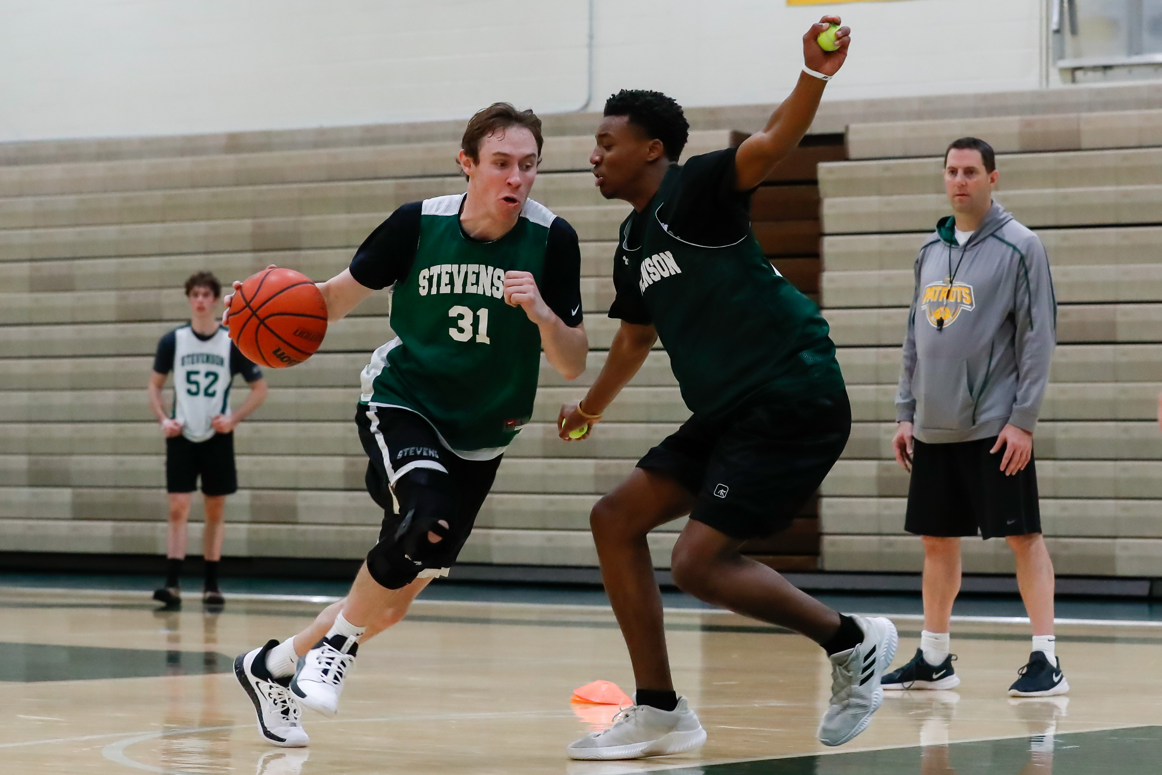 Stevenson's Matthew Ambrose (31) and RJ Holmes (23) in practice on Monday.