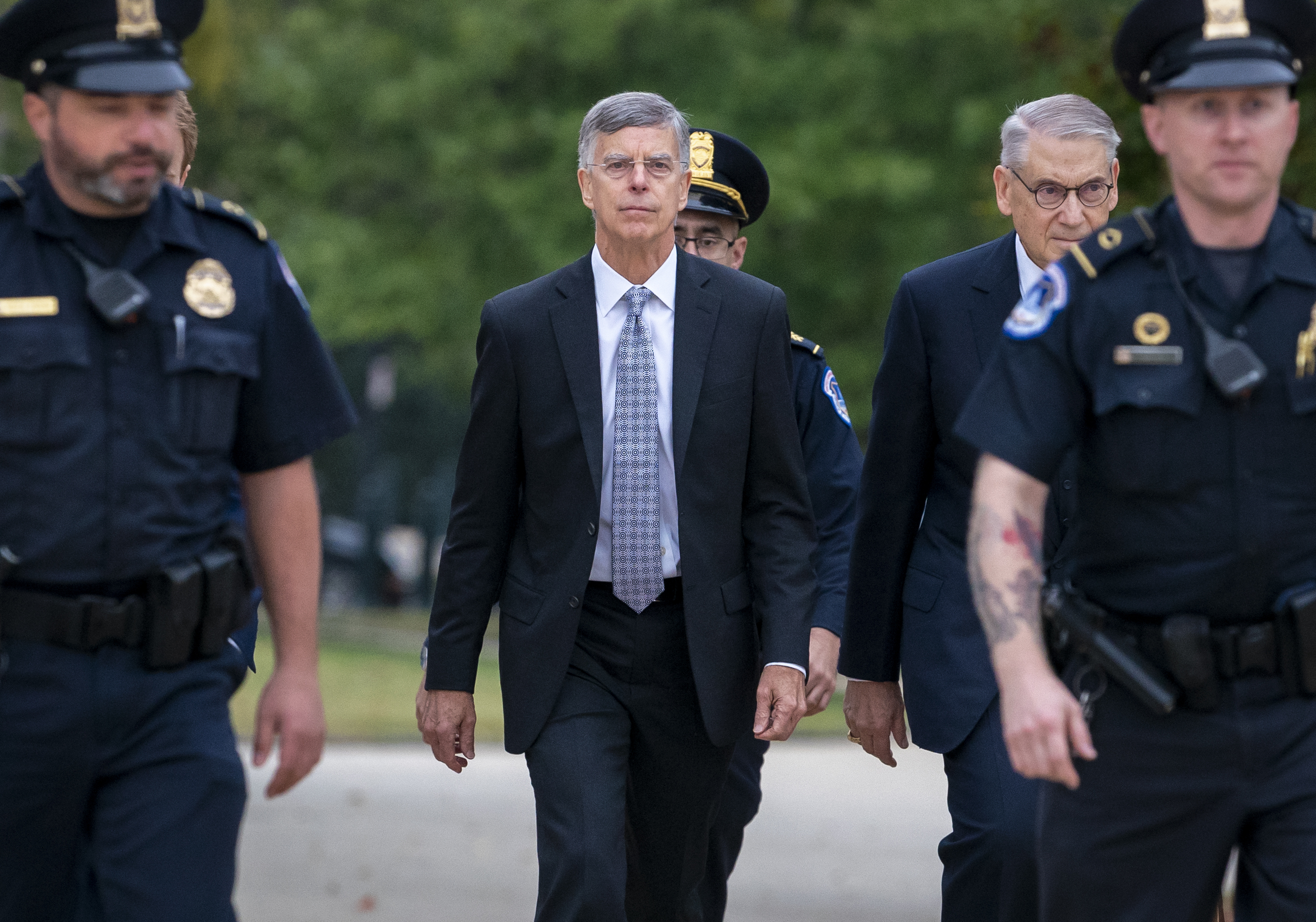Ambassador William Taylor, is escorted by U.S. Capitol Police