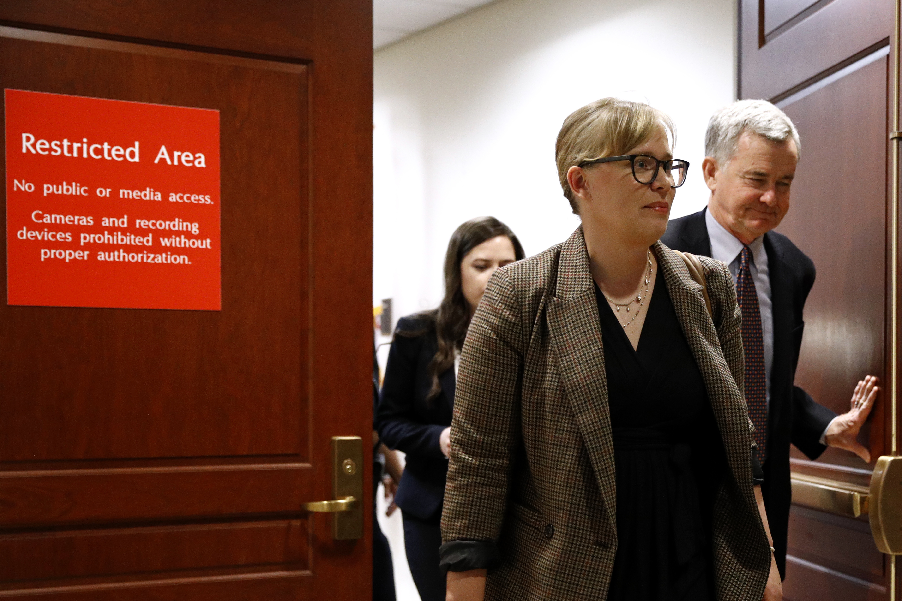 Catherine Croft, a State Department adviser on Ukraine, departs a secure area of the Capitol