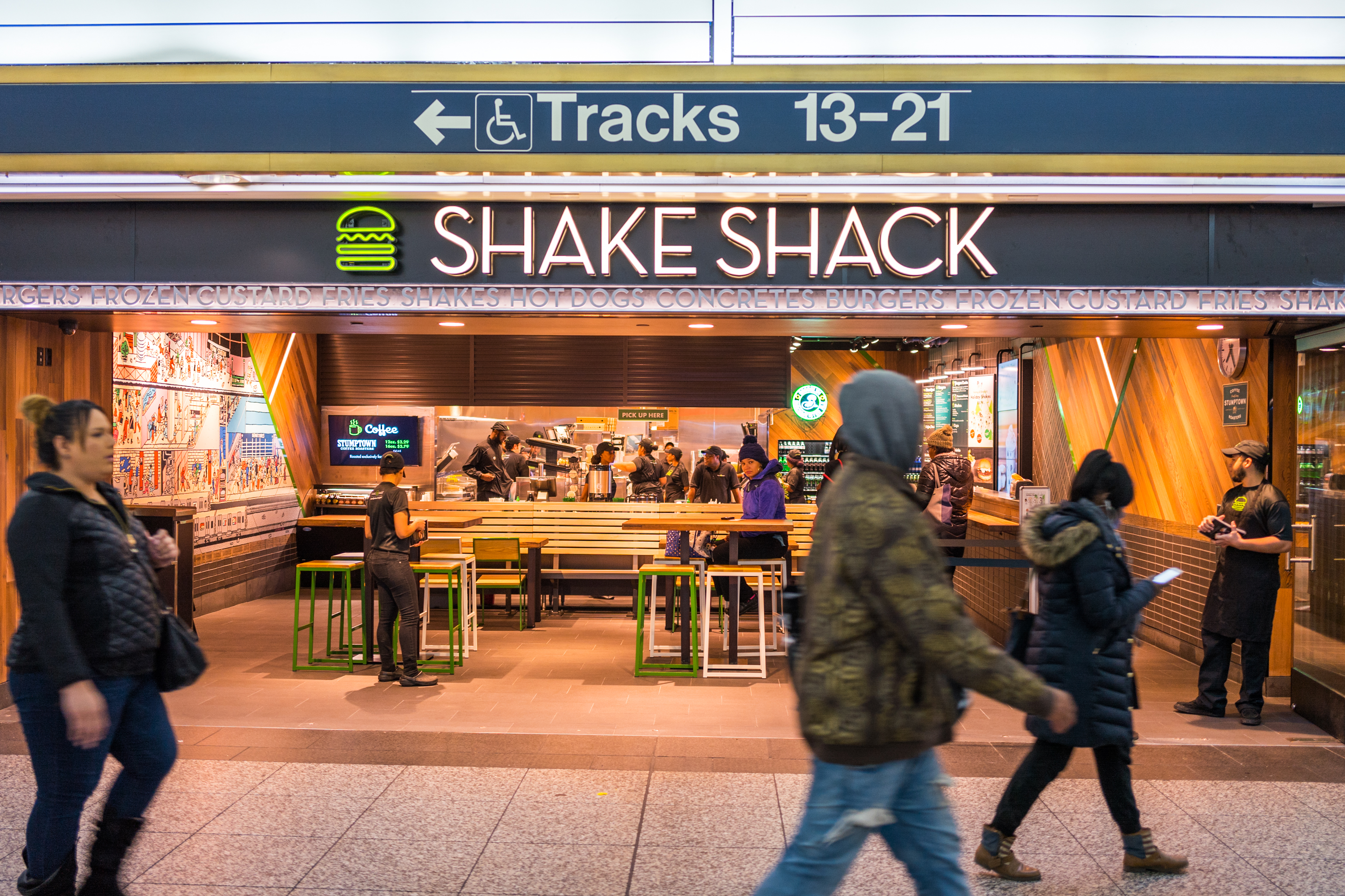 A view of Shake Shack in Penn Station as commuters rush by