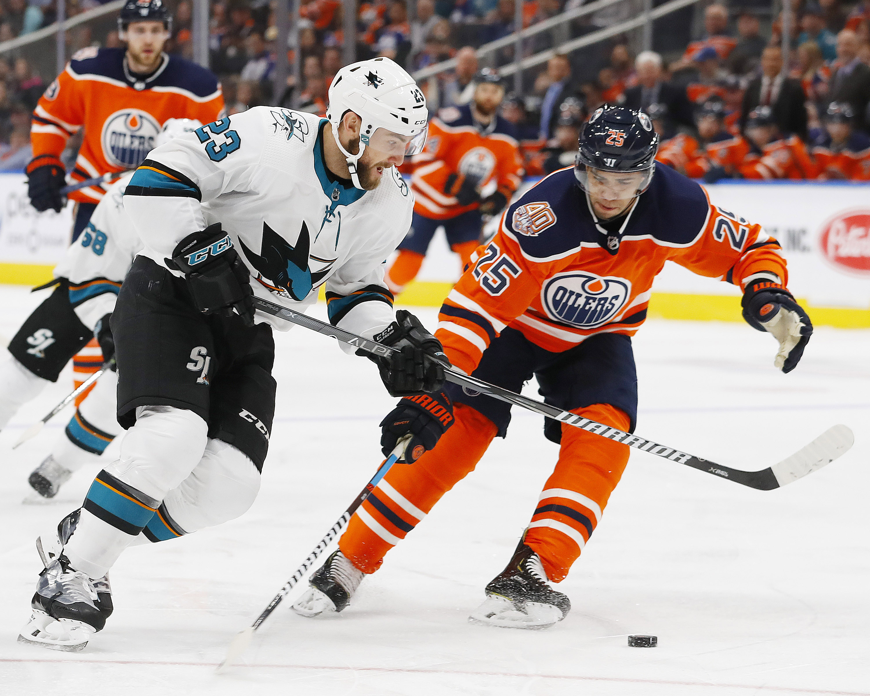 Apr 4, 2019; Edmonton, Alberta, CAN; San Jose Sharks forward Barclay Goodrow (23) and Edmonton Oilers defensemen Darnell Nurse (25) battle for ta loose puck during the second period at Rogers Place.