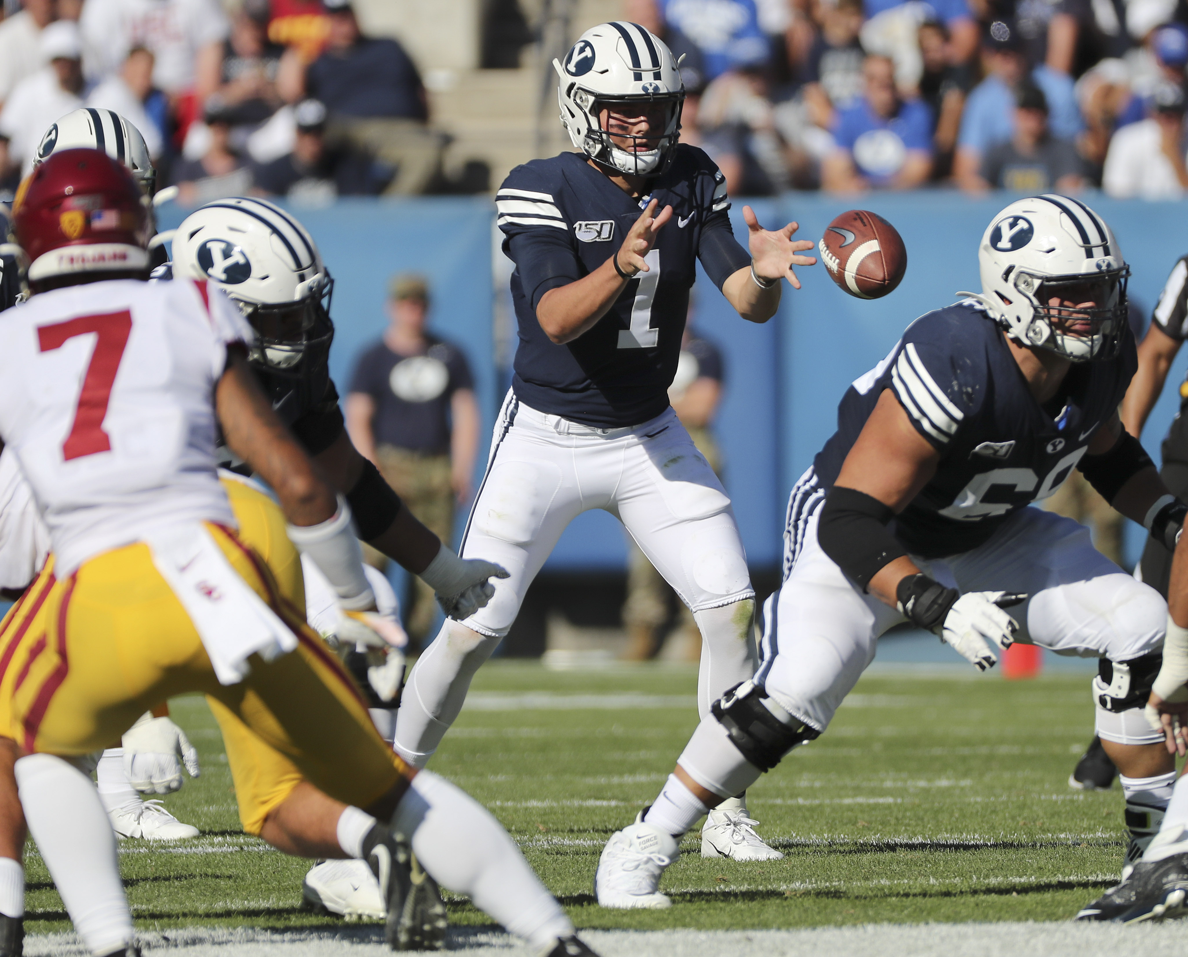 Brigham Young Cougars quarterback Zach Wilson (1) takes a snap in Provo on Saturday, Sept. 14, 2019. BYU won 30-27 in overtime.