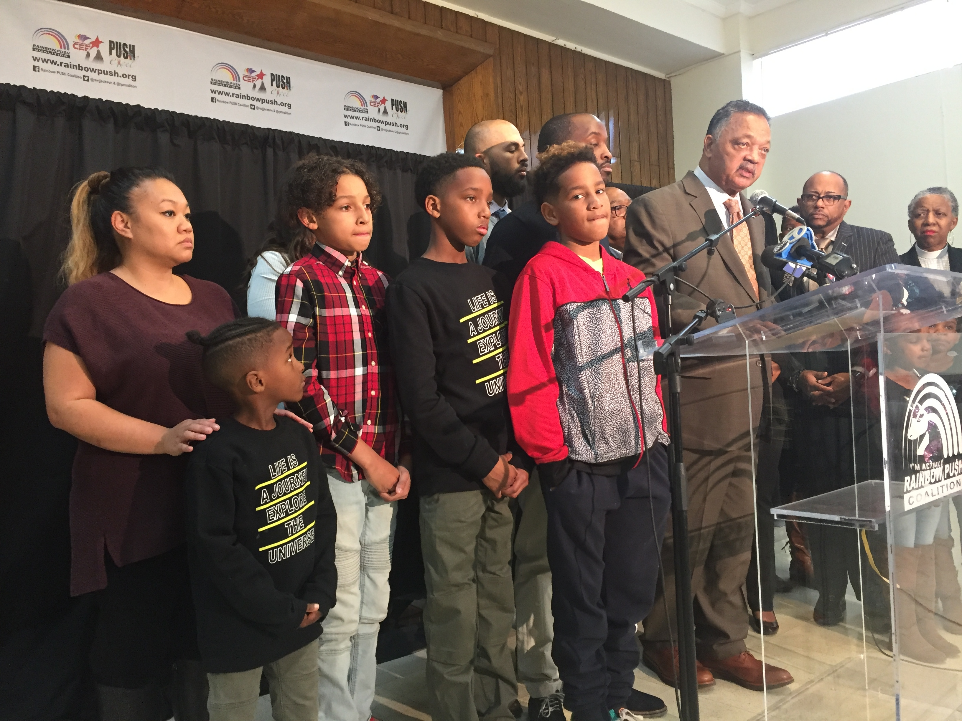 The Rev. Jesse Jackson stands with members of a group who walked out of a Naperville Buffalo Wild Wings restaurant in October because another customer didn't want to sit near African American people.