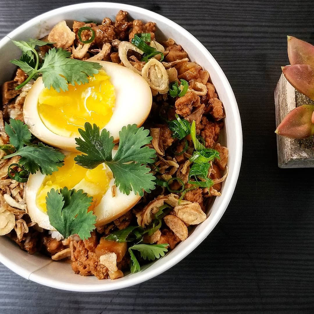 A braised pork rice dish with soy egg on top