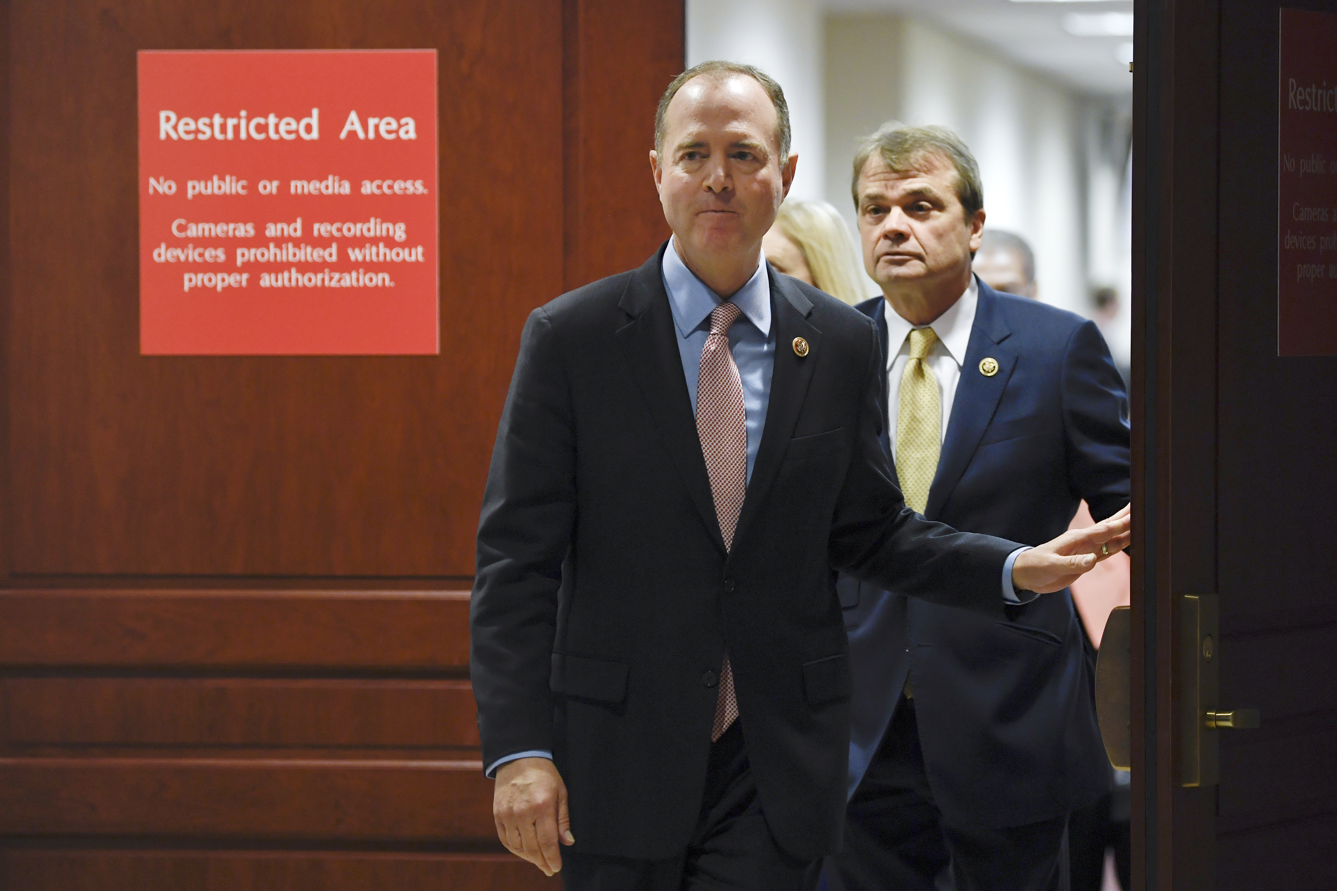 "House Intelligence Committee Chairman Adam Schiff, D-Calif., followed by Rep. Mike Quigley, D-Ill., walks out to talk to reporters on Capitol Hill in Washington, Wednesday, Nov. 6, 2019, about the House impeachment inquiry. (AP Photo/Susan Walsh) The two are leaving the Sensitive Compartmented Information Facility, nicknamed the ""SCIF."""