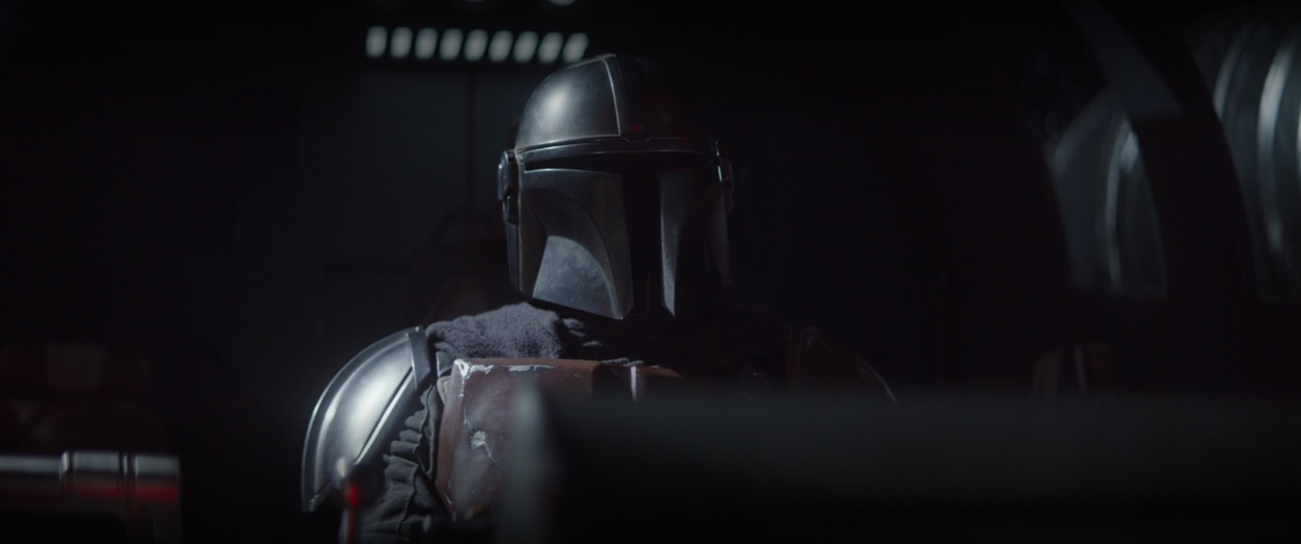 The Mandalorian with his shiny new pauldron on his right shoulder