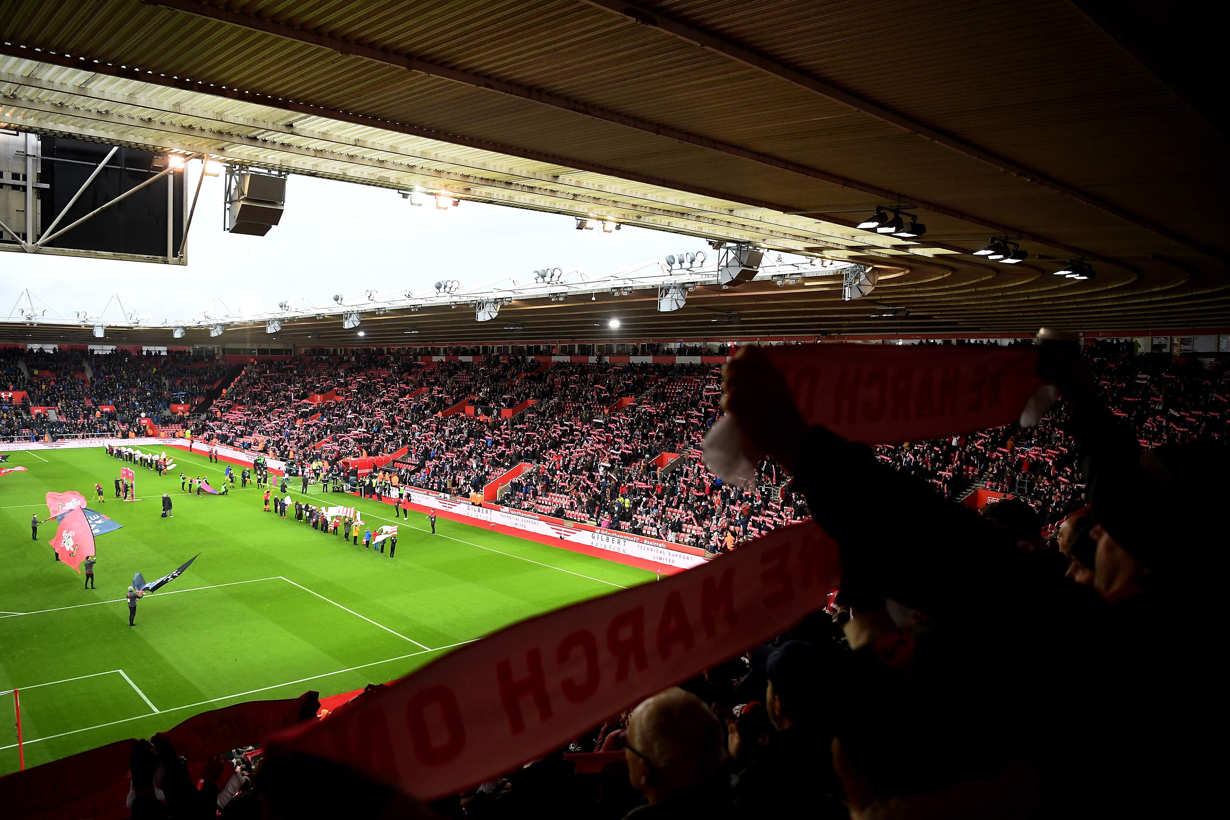 Southampton fans raising their free scarves at St Mary's against Everton in the Premier League