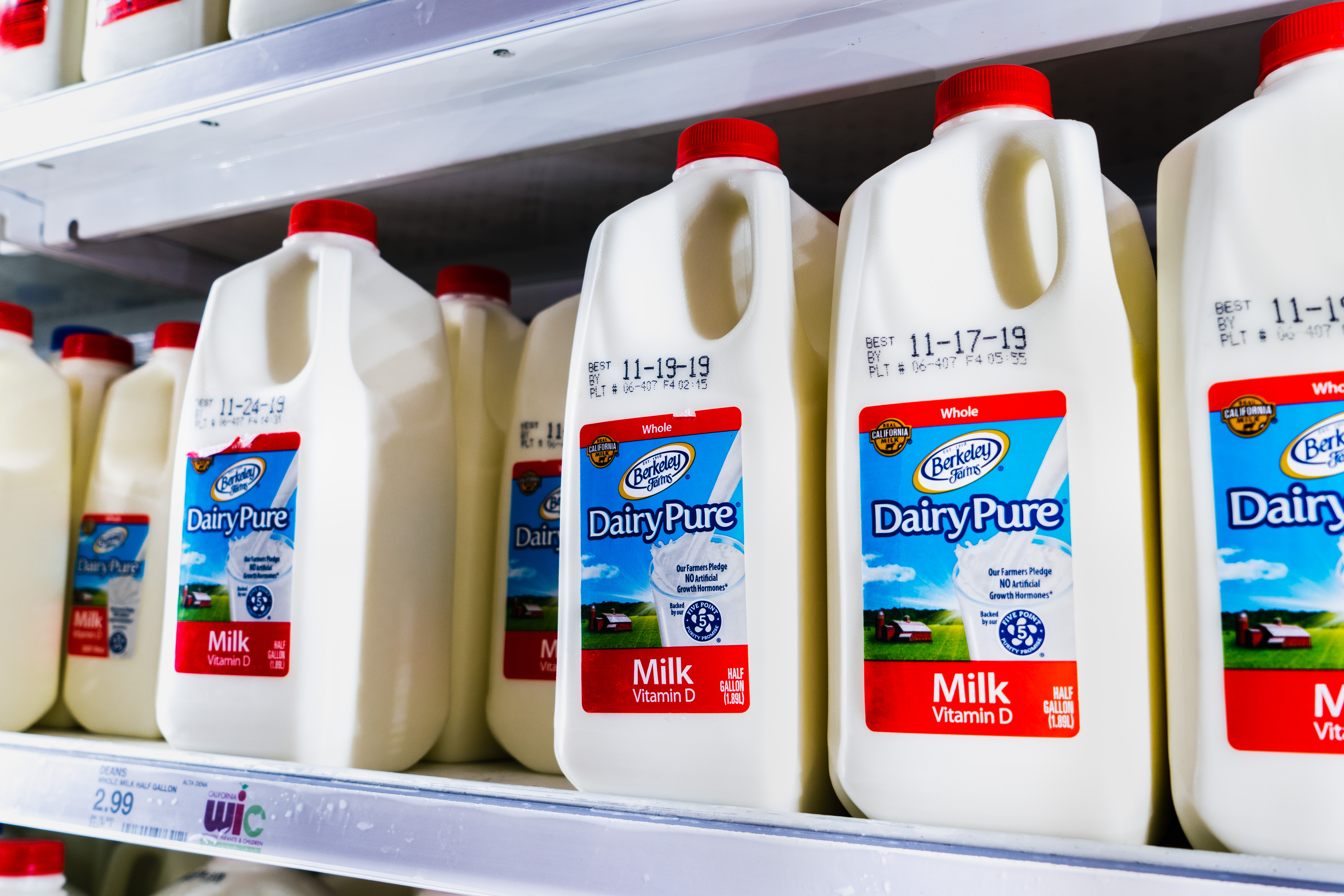 A grocery store aisle displaying half-gallon jugs of DairyPure milk.