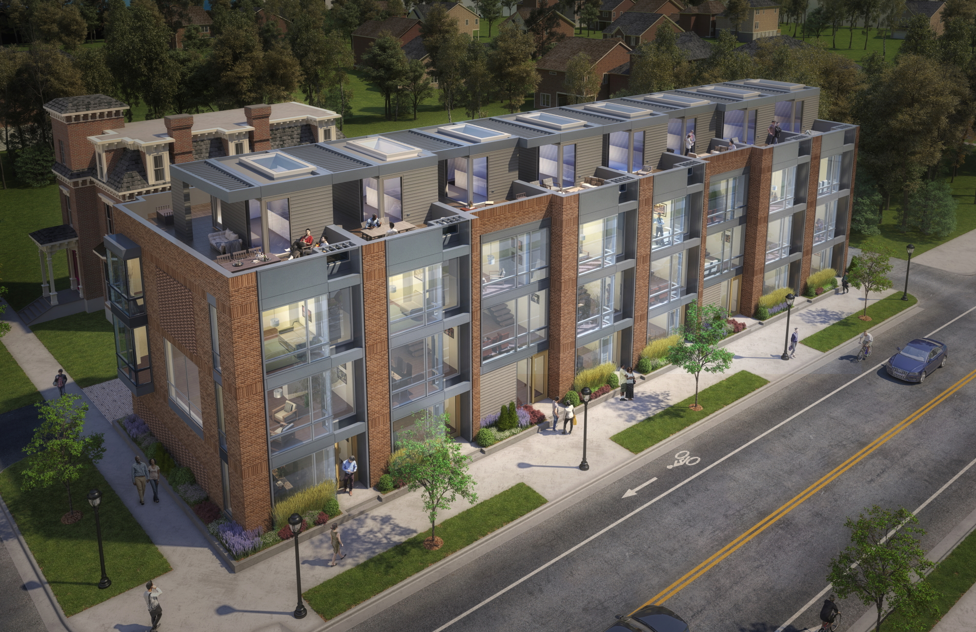 A rectangular building with eight connected four-story townhomes. The facade is made up of brick columns, and large metal and glass windows.