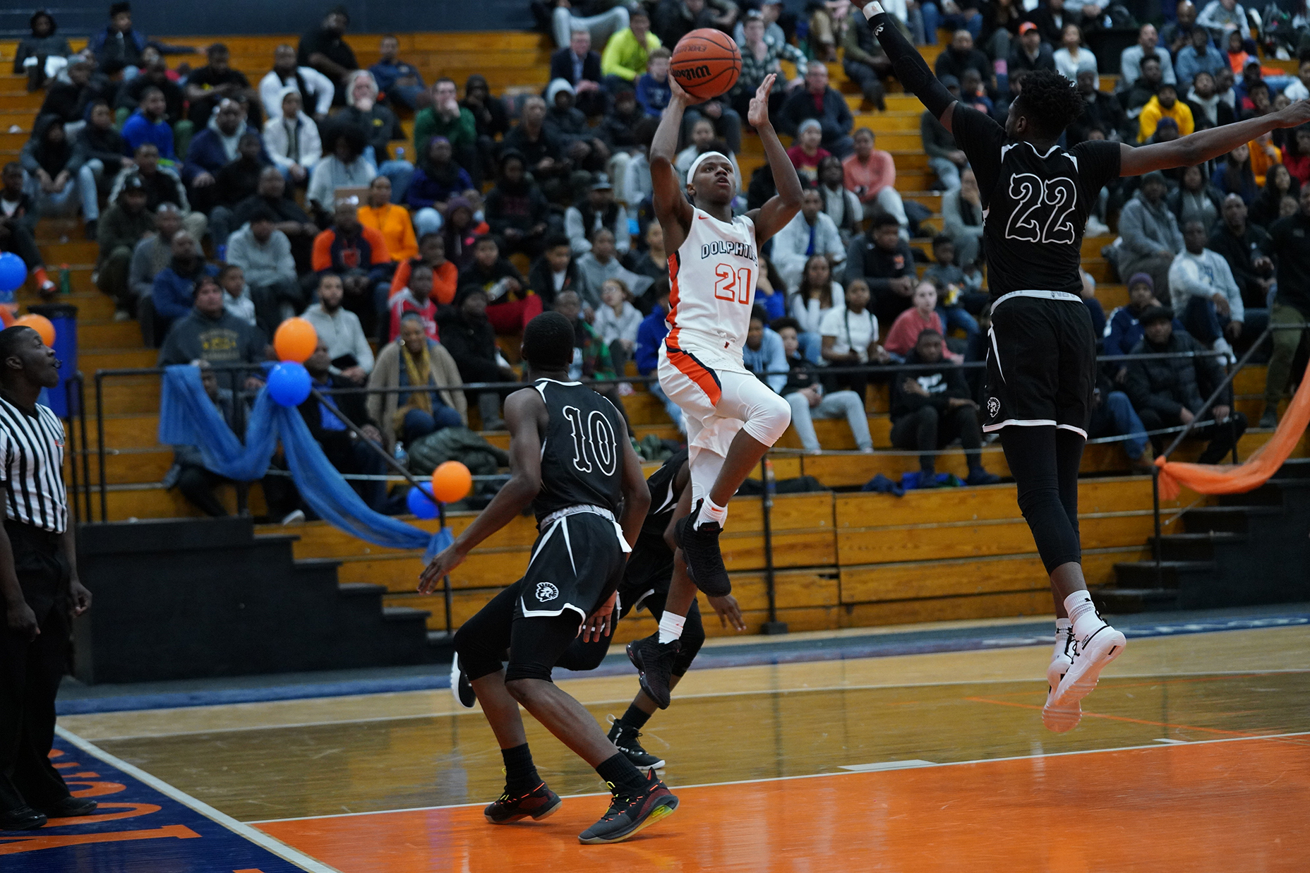 Young's DJ Steward (21) makes his way to the rim against Orr.