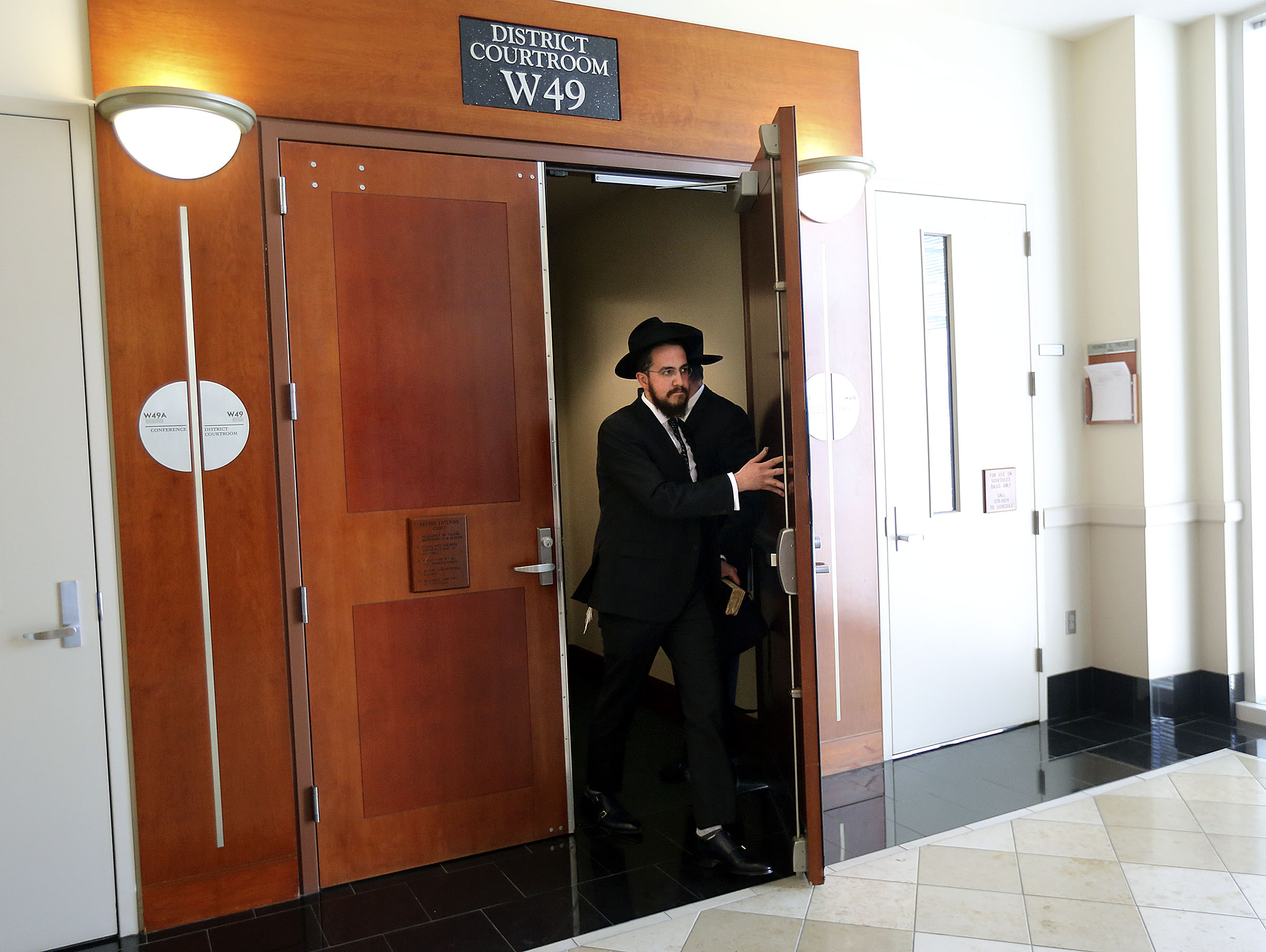 Rabbi Avremi Zippel leaves the courtroom during a break in the trial of Alavina Fungaihea Florreich, who is accused of sexually abusing him when he was a child and she was his nanny, at the Matheson Courthouse in Salt Lake City on Tuesday, Nov. 12, 2019.