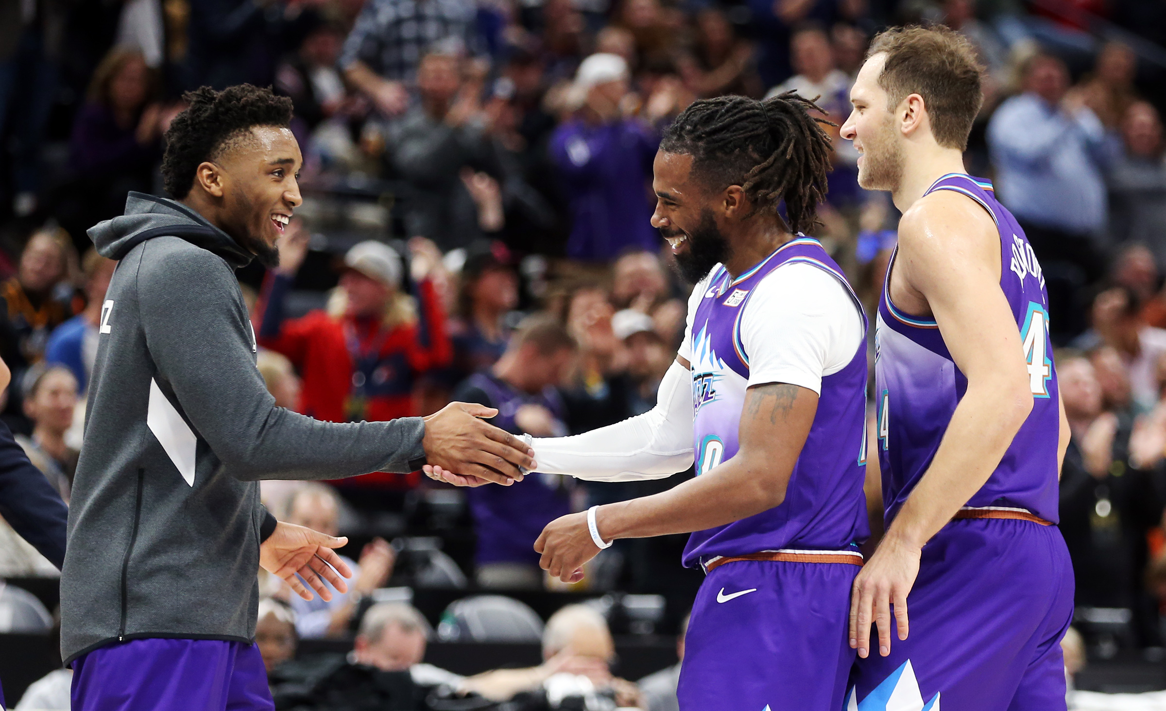 Utah Jazz guard Donovan Mitchell (45) congratulates teammate Utah Jazz guard Mike Conley (10) at a timeout as the Utah Jazz and the LA Clippers play an NBA basketball game at Vivint Arena in Salt Lake City on Wednesday, Oct. 30, 2019. Jazz won 110-96.