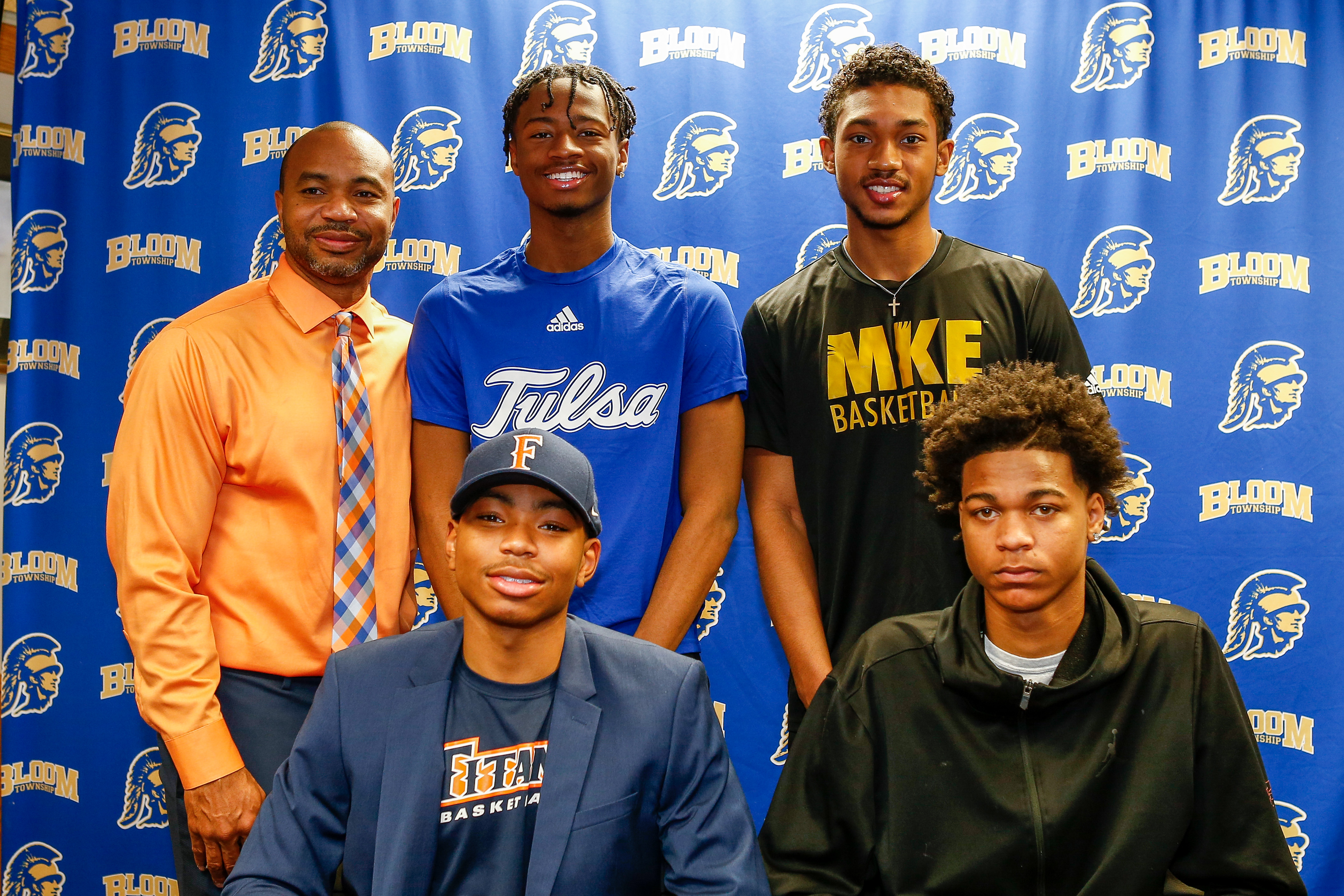 Bloom coach Dante Maddox Sr. with his son Dante Maddox Jr. (Cal State-Fullerton), Martice Mitchell (Minnesota), Donovan Newby (Wisconsin-Milwaukee) and Keshawn Williams (Tulsa) on signing day, November 12, 2019.