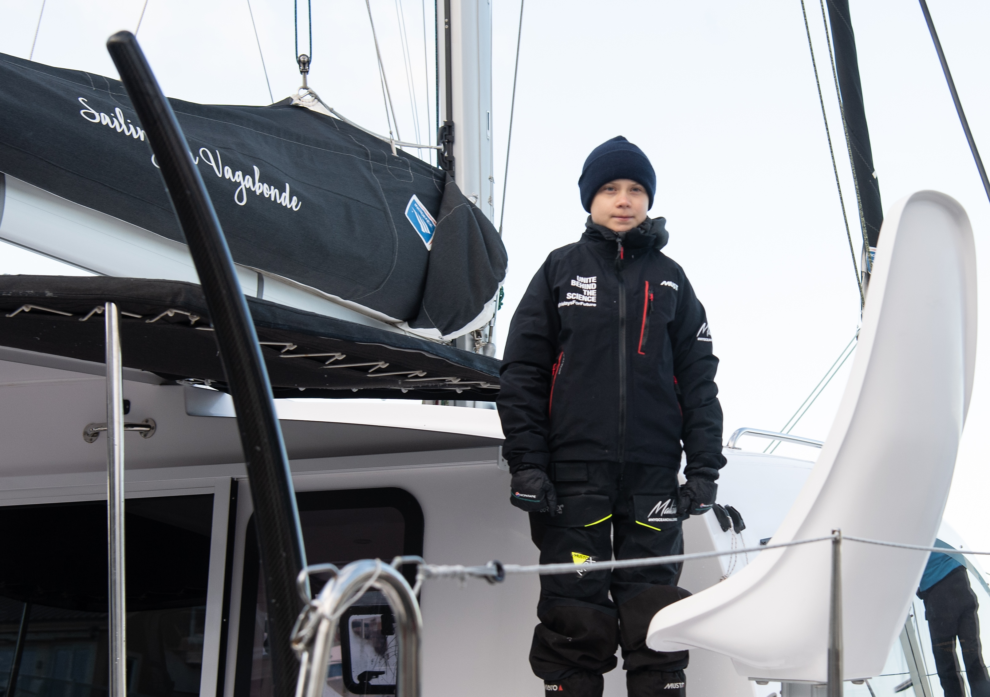 Swedish climate activist Greta Thunberg stands aboard the catamaran La Vagabonde as she sets sail to Europe in Hampton, Virginia, on November 13, 2019.