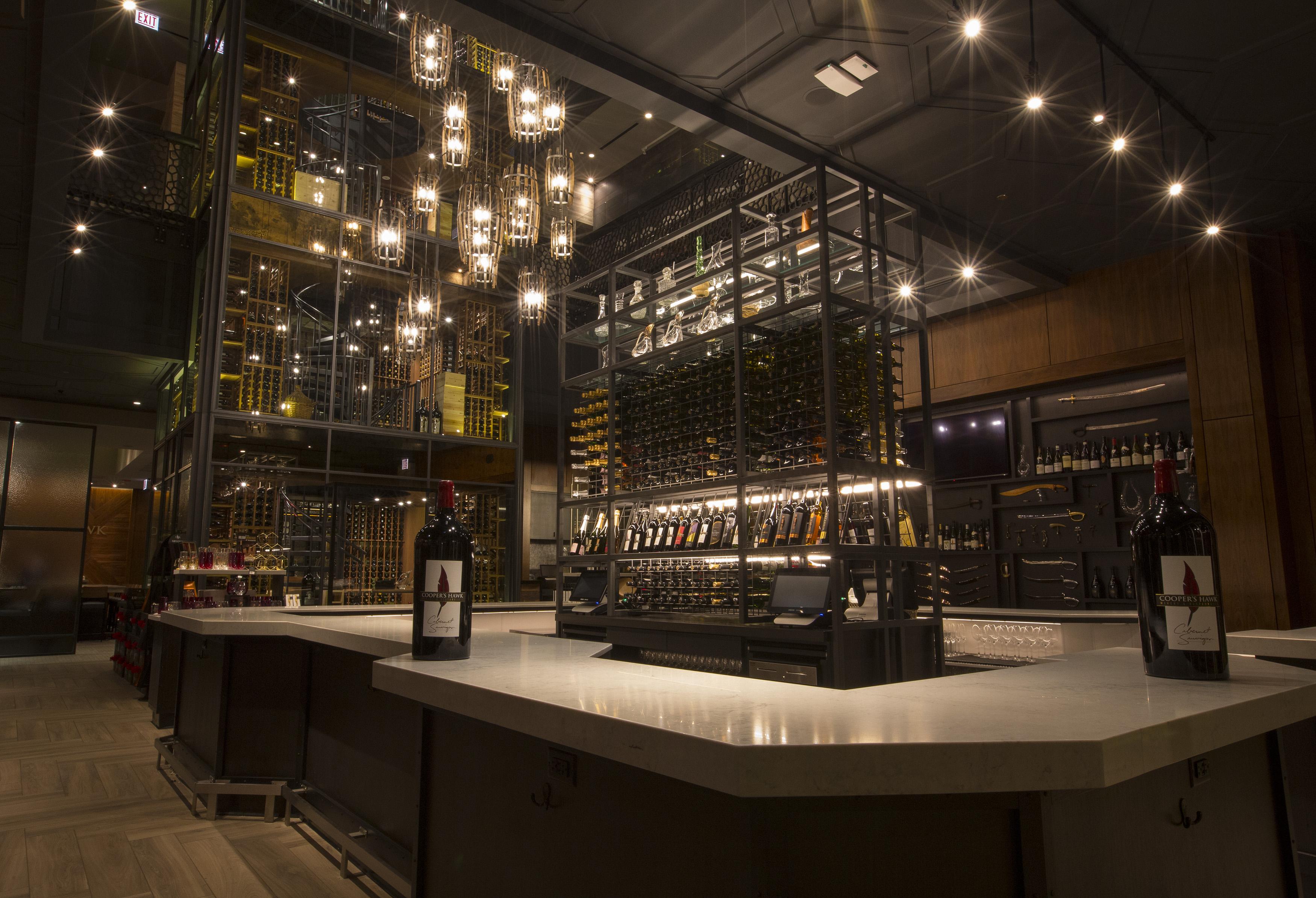 A three-floor wine tower inside a bar.