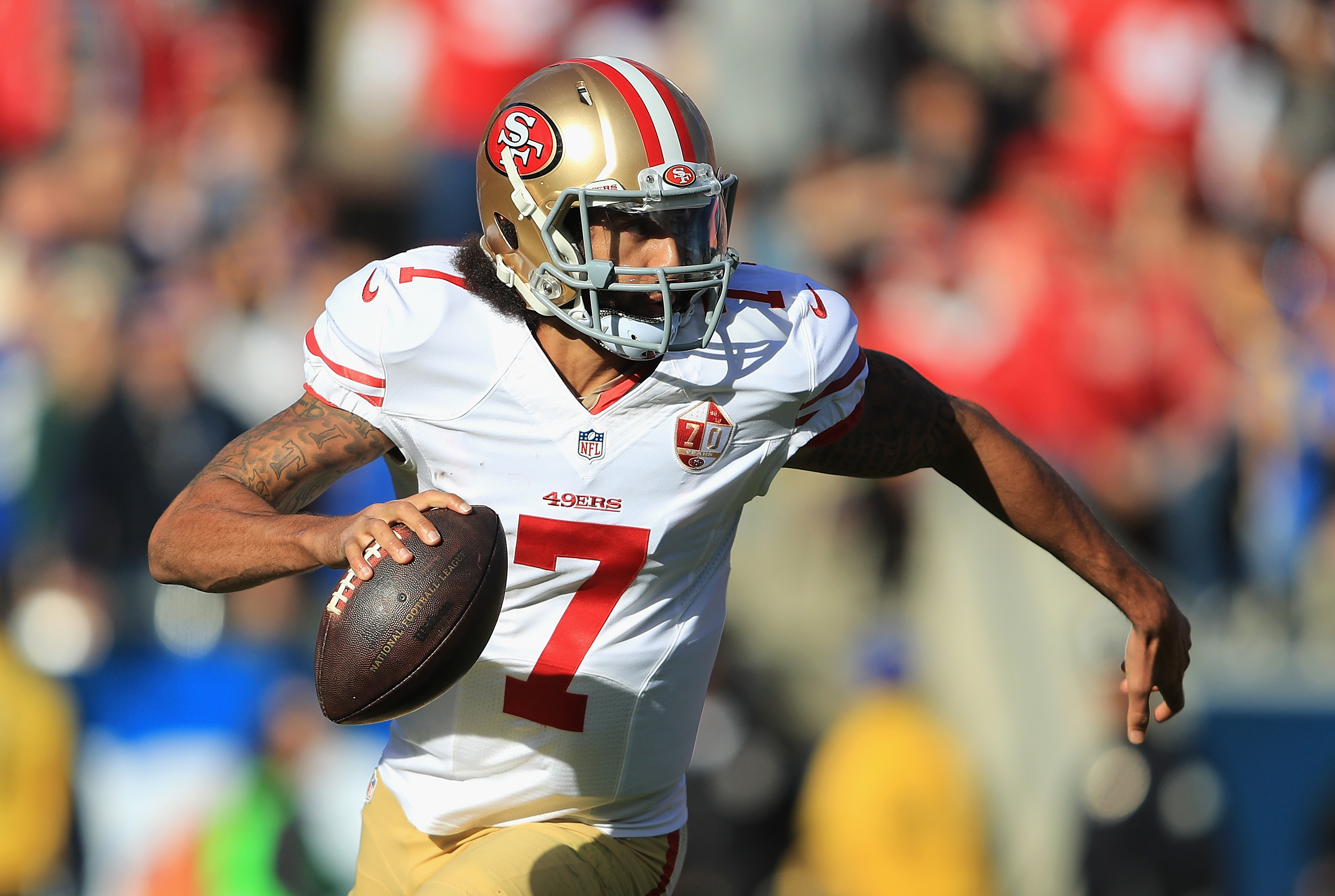 San Francisco quarterback Colin Kaepernick scrambles against the Rams during a 2016 game.