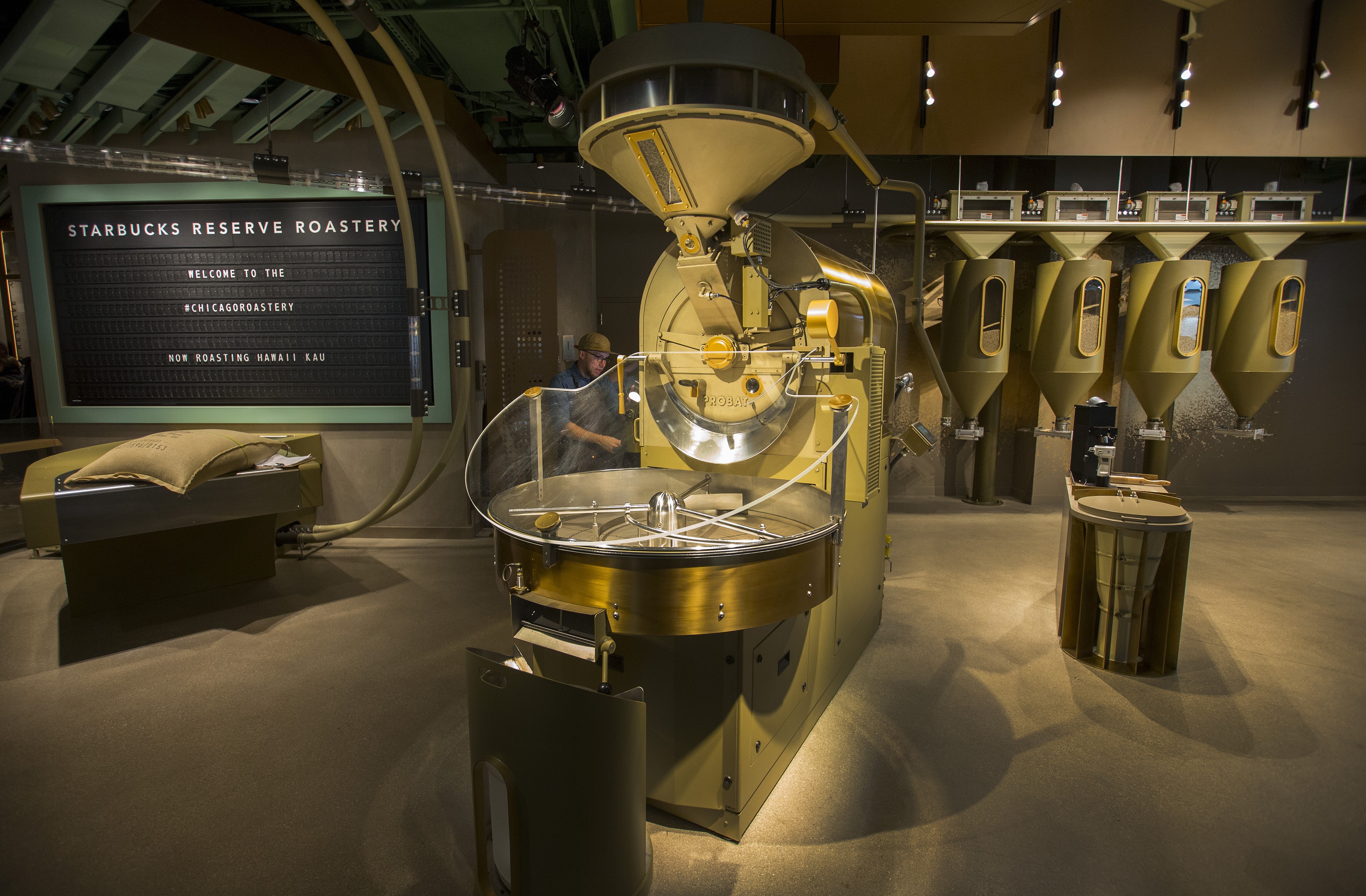 A man roasting coffee beans inside the world's largest Starbucks.