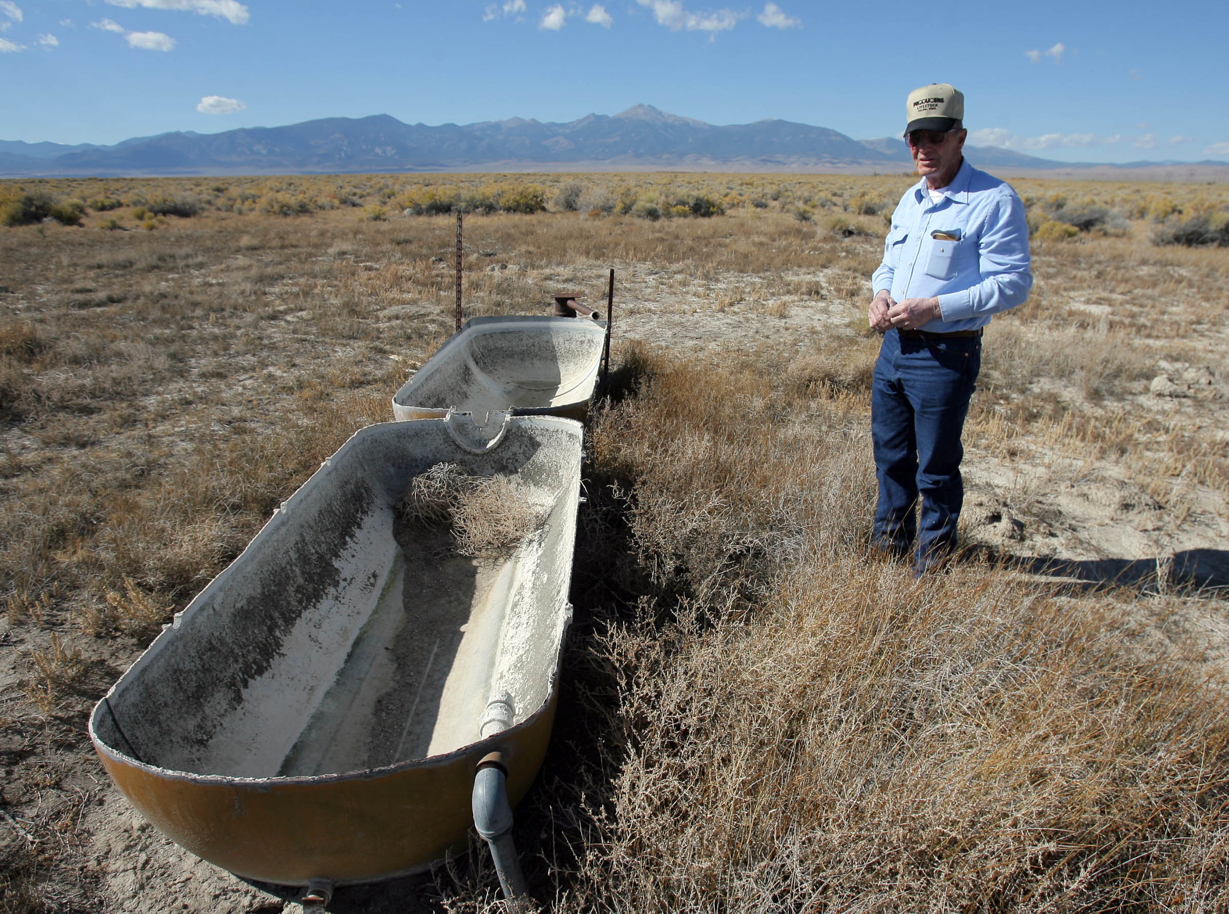 Rancher Dean Baker, a member of the negotiating committee for the Snake Valley aquifer water sharing agreement under consideration by Nevada and Utah officials, stands next to an old trough on the Nevada side of the Snake Valley on Monday, Oct. 19, 2009. The trough was supplied by groundwater until a few years ago.