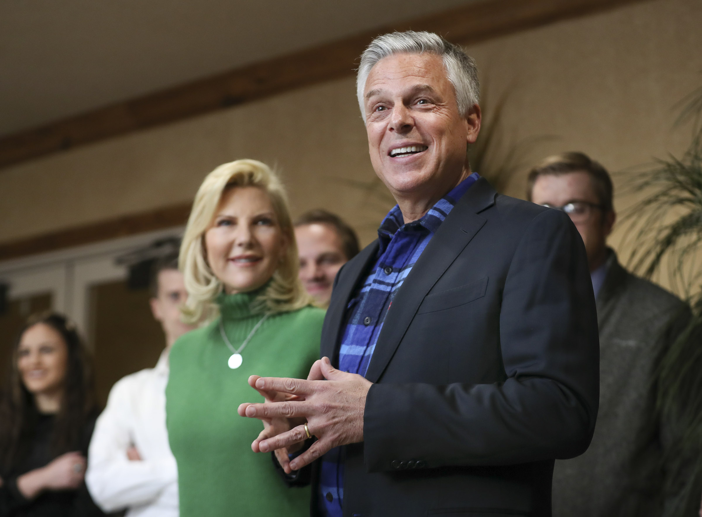 Jon Huntsman Jr. and his wife, Mary Kaye, talk with employees and clients at KKOS Lawyers and K&E CPAs in their offices in Cedar City shortly after announcing he is running for a third term as Utah's governor on Thursday, Nov. 14, 2019.