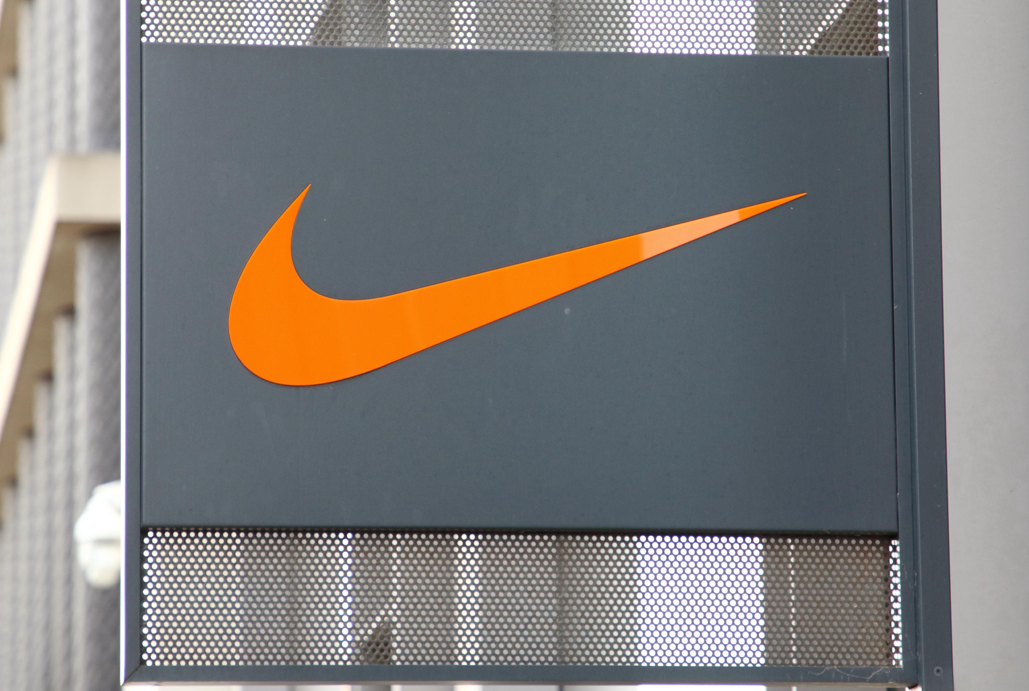Nike Swoosh logo outside a Nike shop