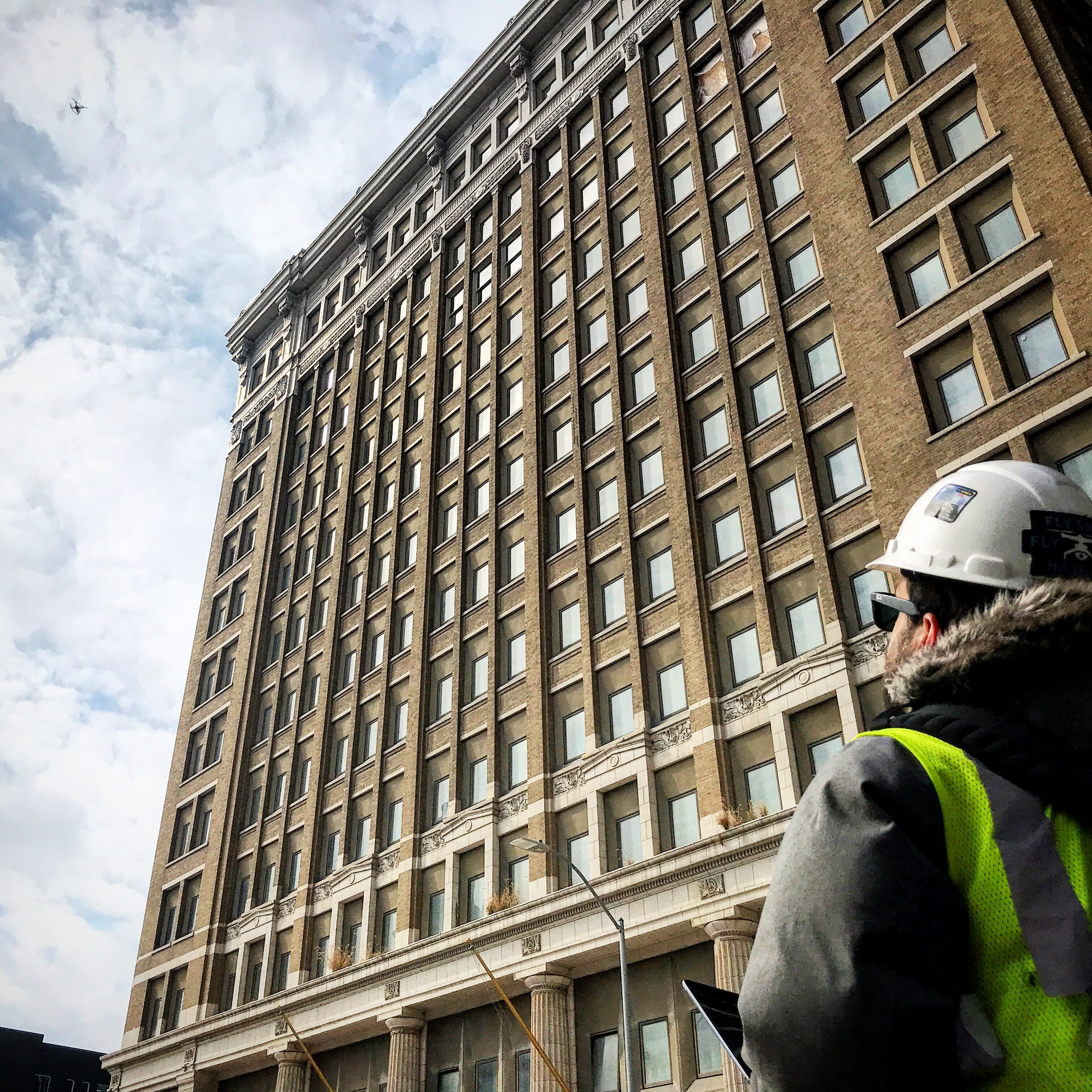 Helios Visions co-founder and chief pilot Tyler Gibson operates a drone on the job in for the renovation of Midland Bank in Des Moines, Iowa.