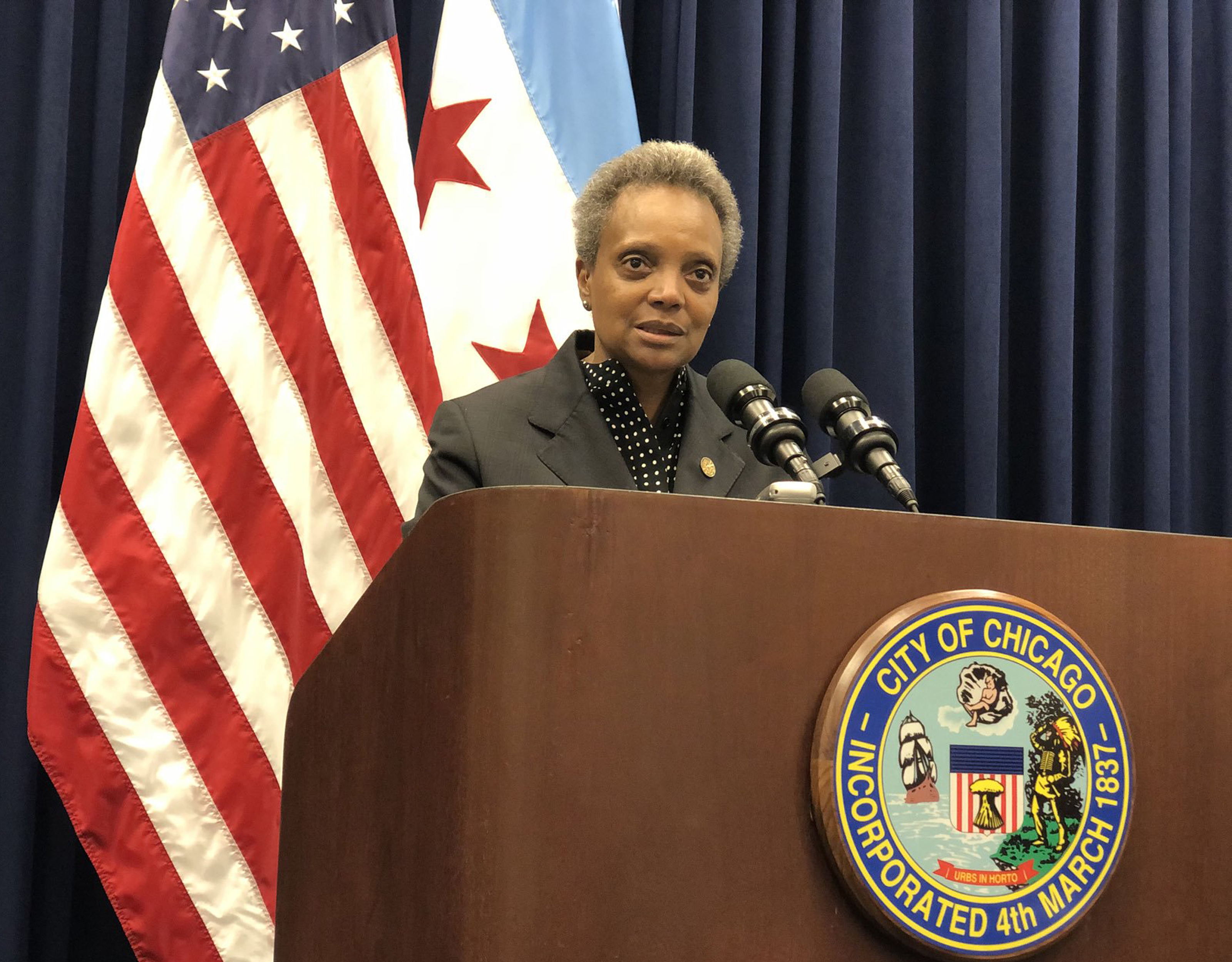 Mayor Lori Lightfoot talks to reporters after Wednesday's City Council meeting.
