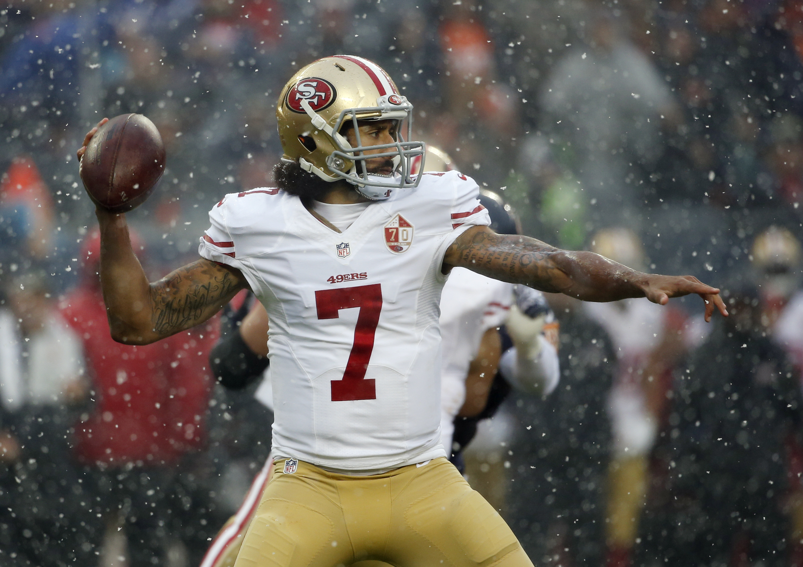 Former 49ers quarterback Colin Kaepernick throws a pass in the Soldier Field snow in 2016.