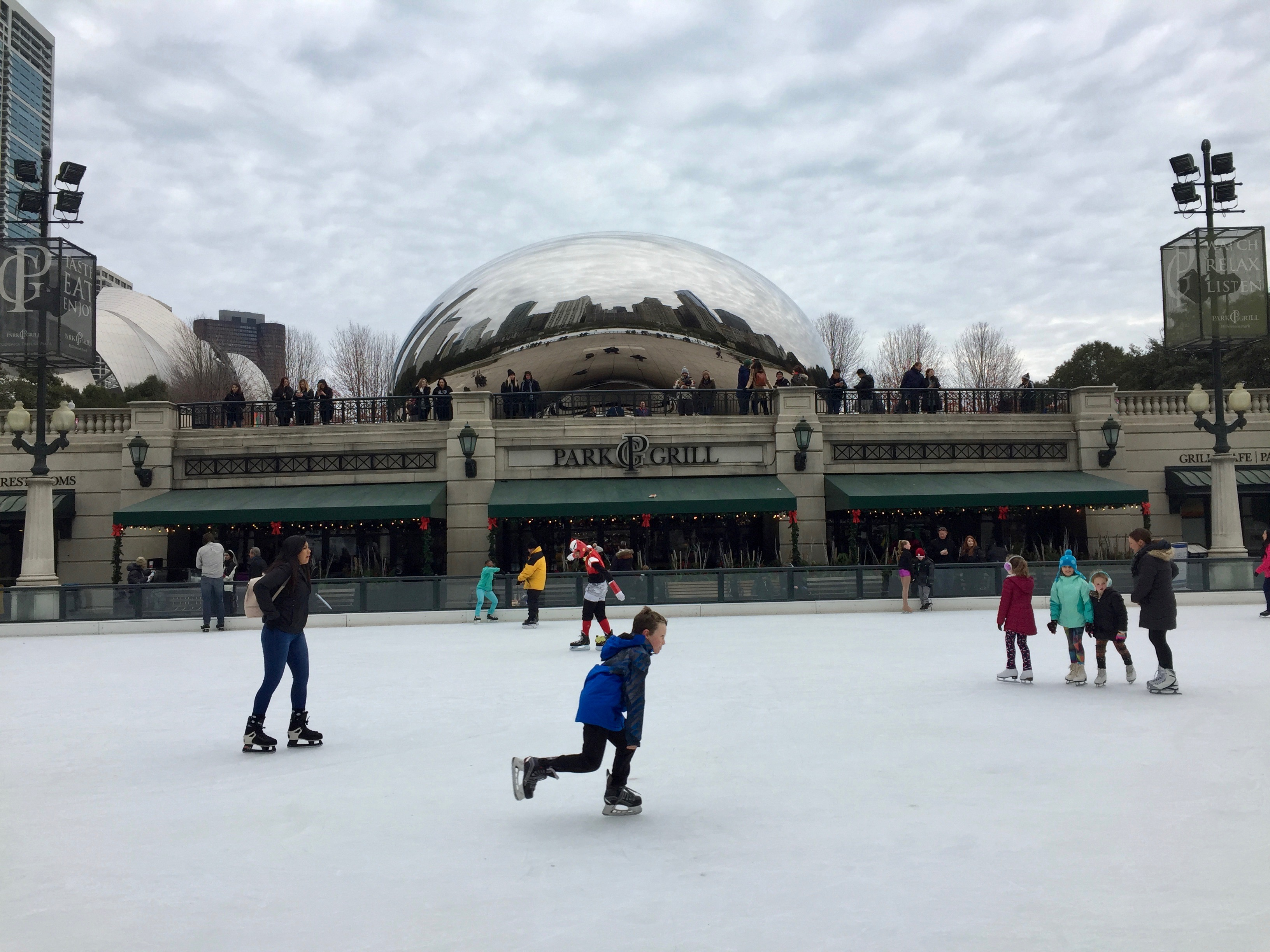 Chicagoans hit the ice during the first day of skating at Millennium Park.
