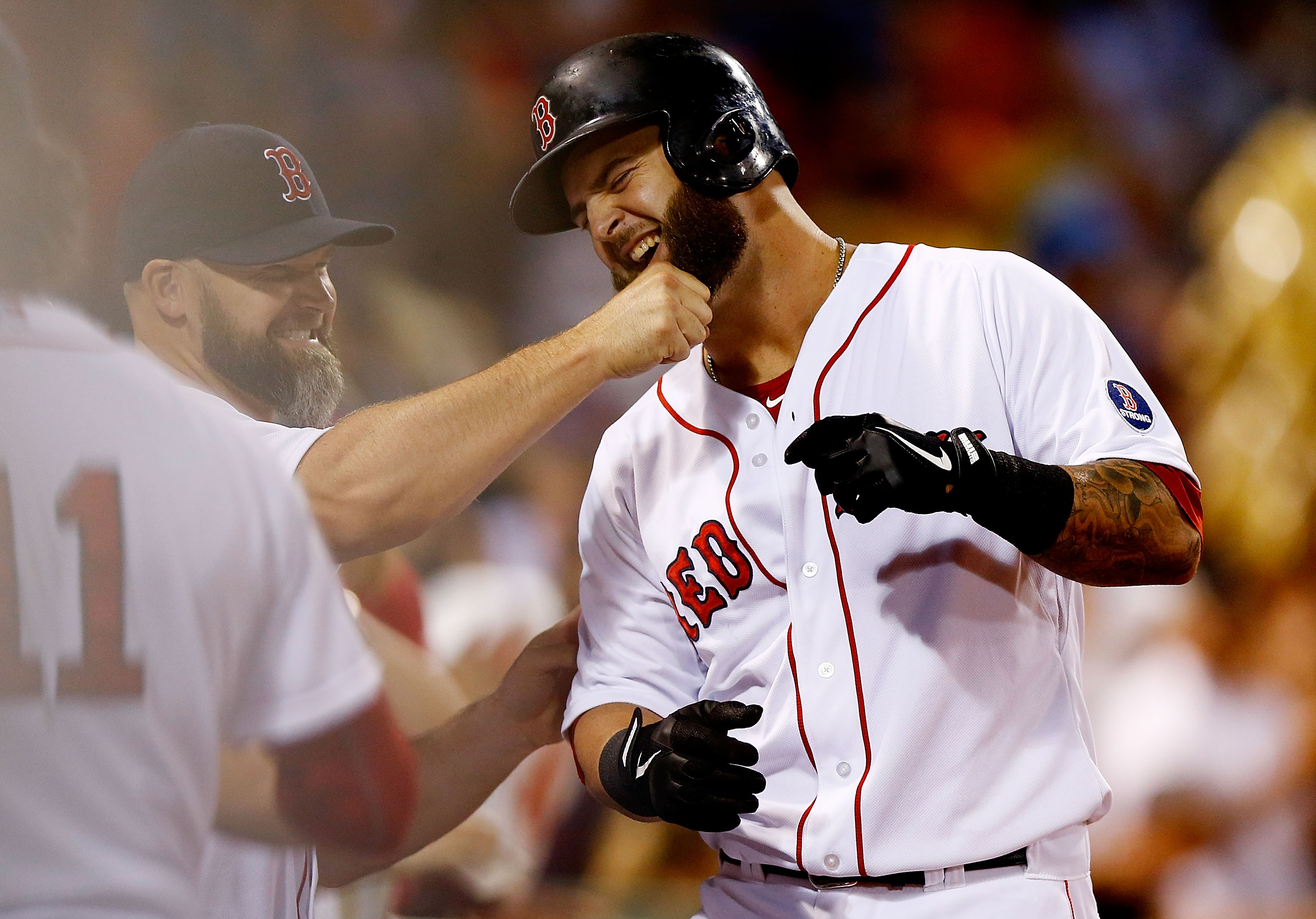 Mike Napoli and David Ross as Red Sox teammates in 2013.