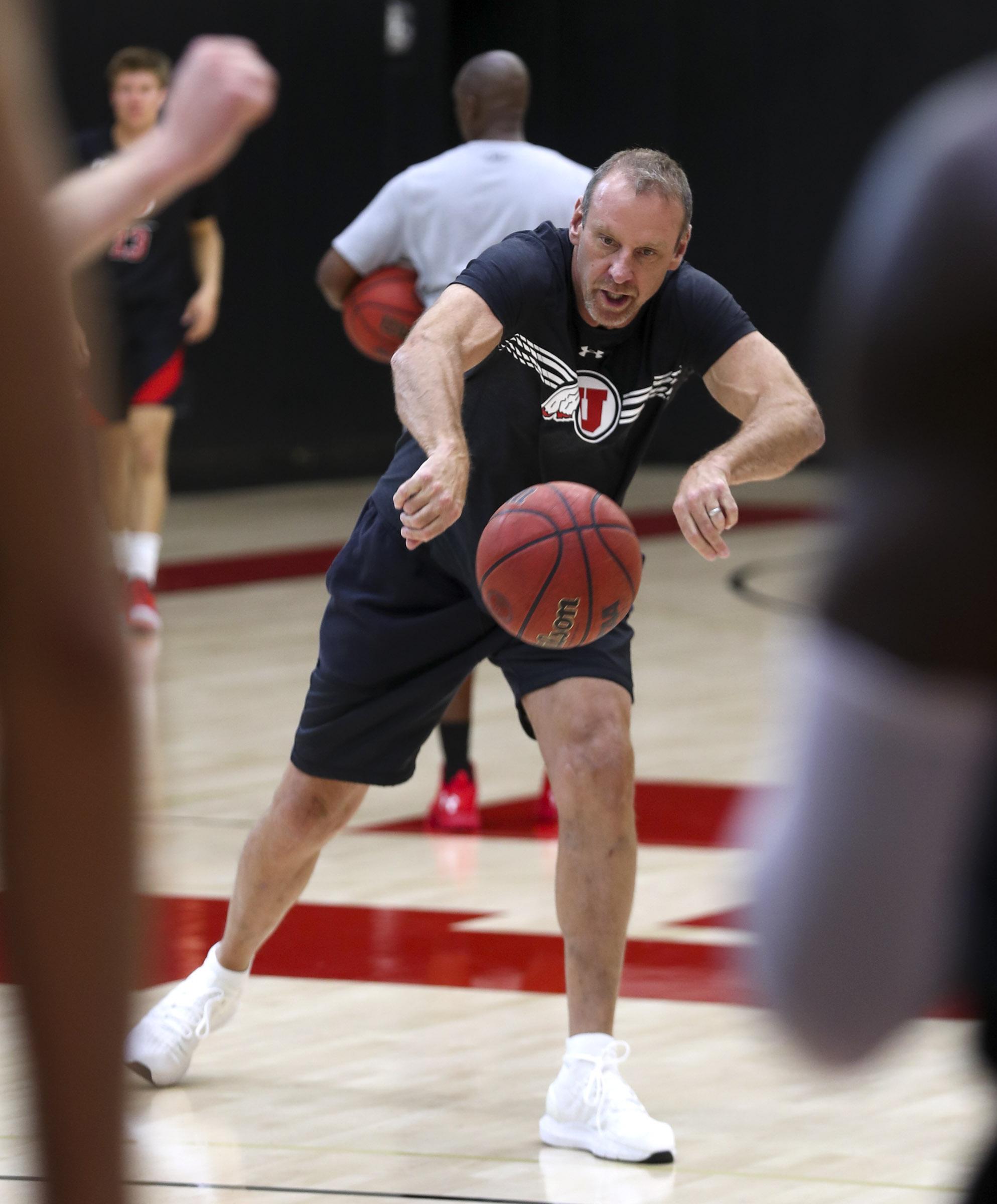 Utah head coach Larry Krystkowiak passes balls to his post players as the University of Utah men's basketball program begins official practices at the Jon M. and Karen Huntsman Basketball Facility in Salt Lake City on Wednesday, Sept. 25, 2019.