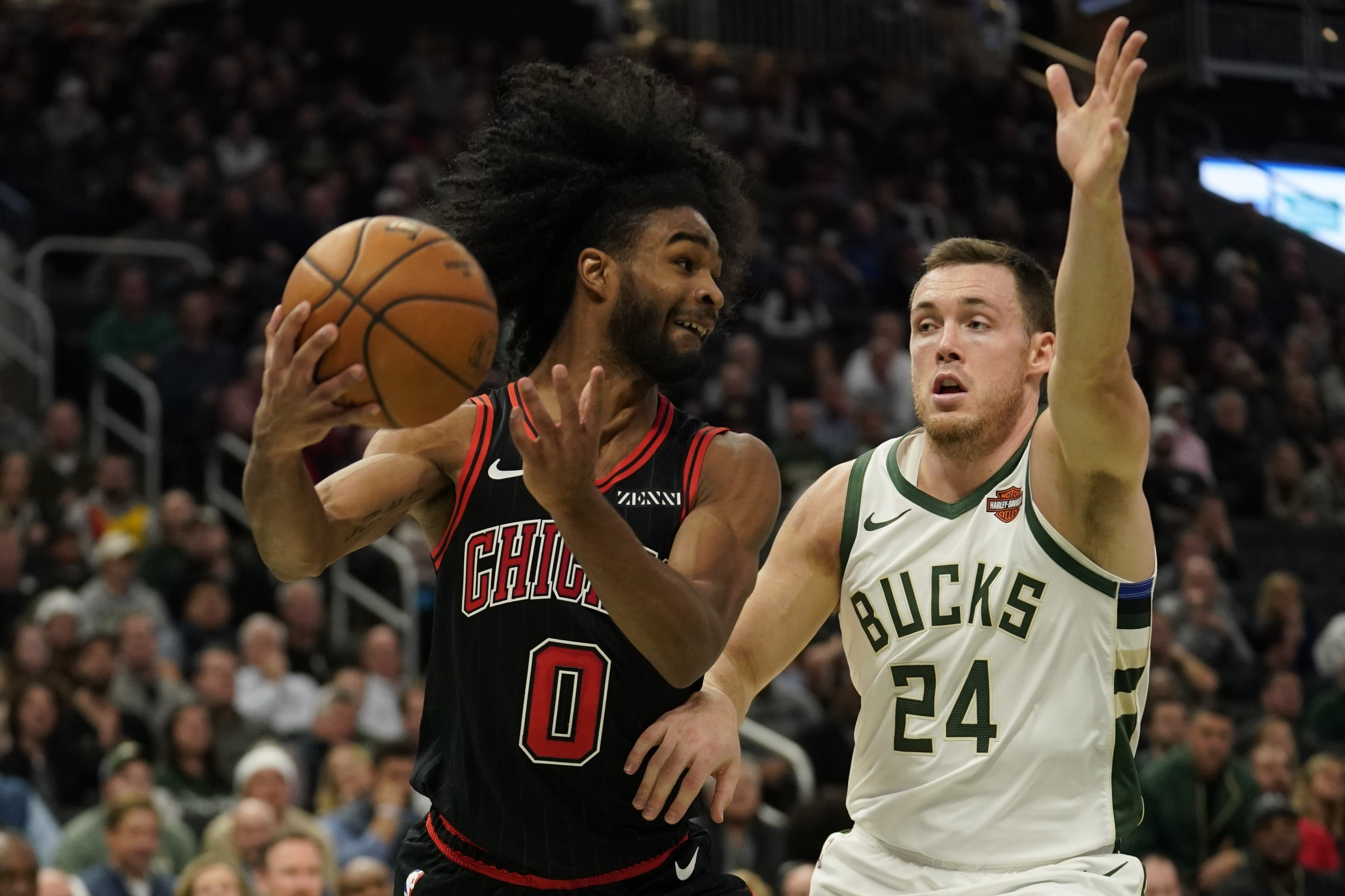 The Bulls' Coby White tries to drive past the Milwaukee Bucks' Pat Connaughton during the second half Thursday night in Milwaukee. The Bucks won 124-115.
