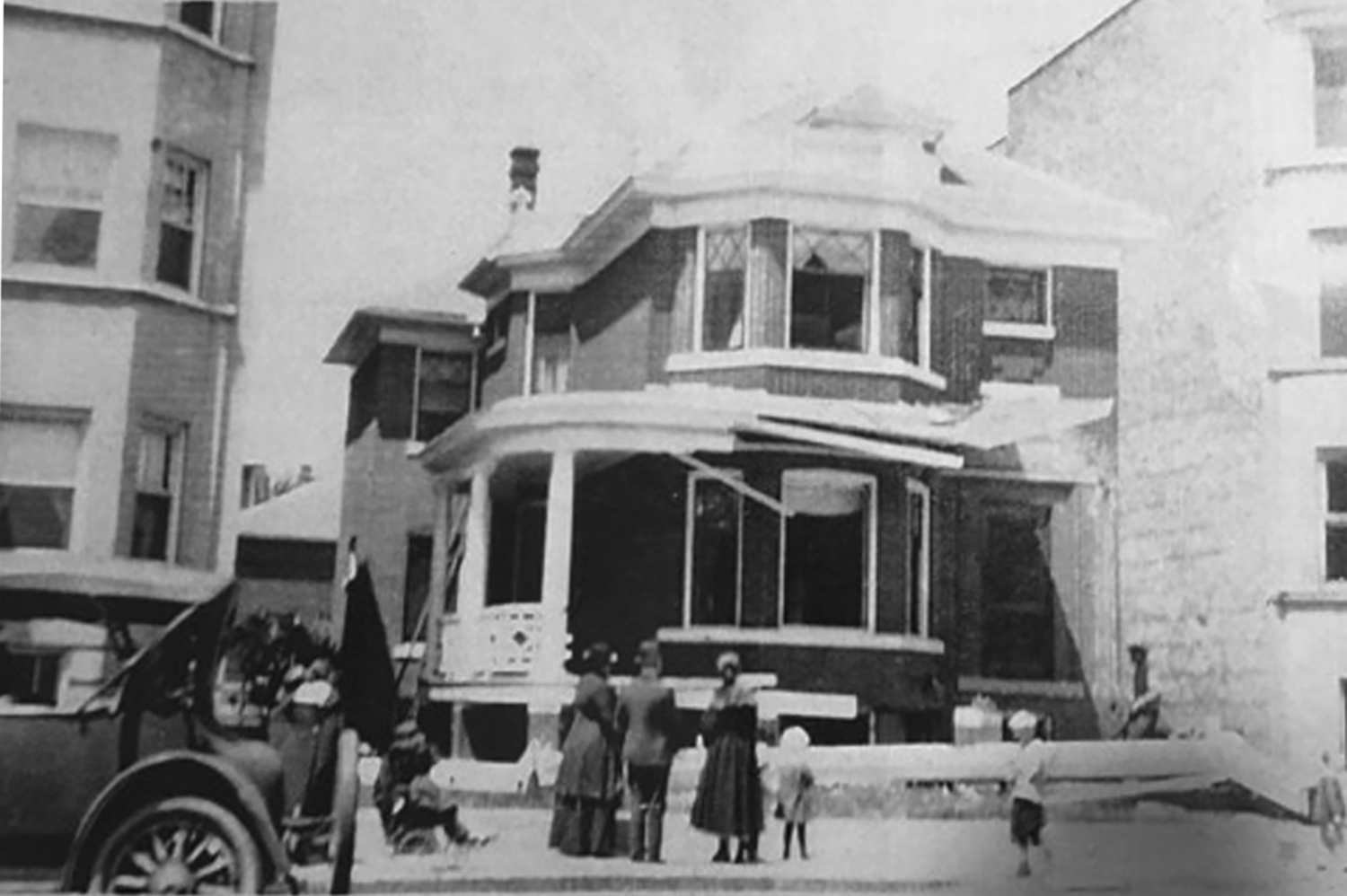 Chicago banker Jesse Binga's house after a bomb exploded on his front porch. This photo isn't dated but likely was from either the summer of 1920 or 1921 — Binga's house was bombed and damaged both of those summers.