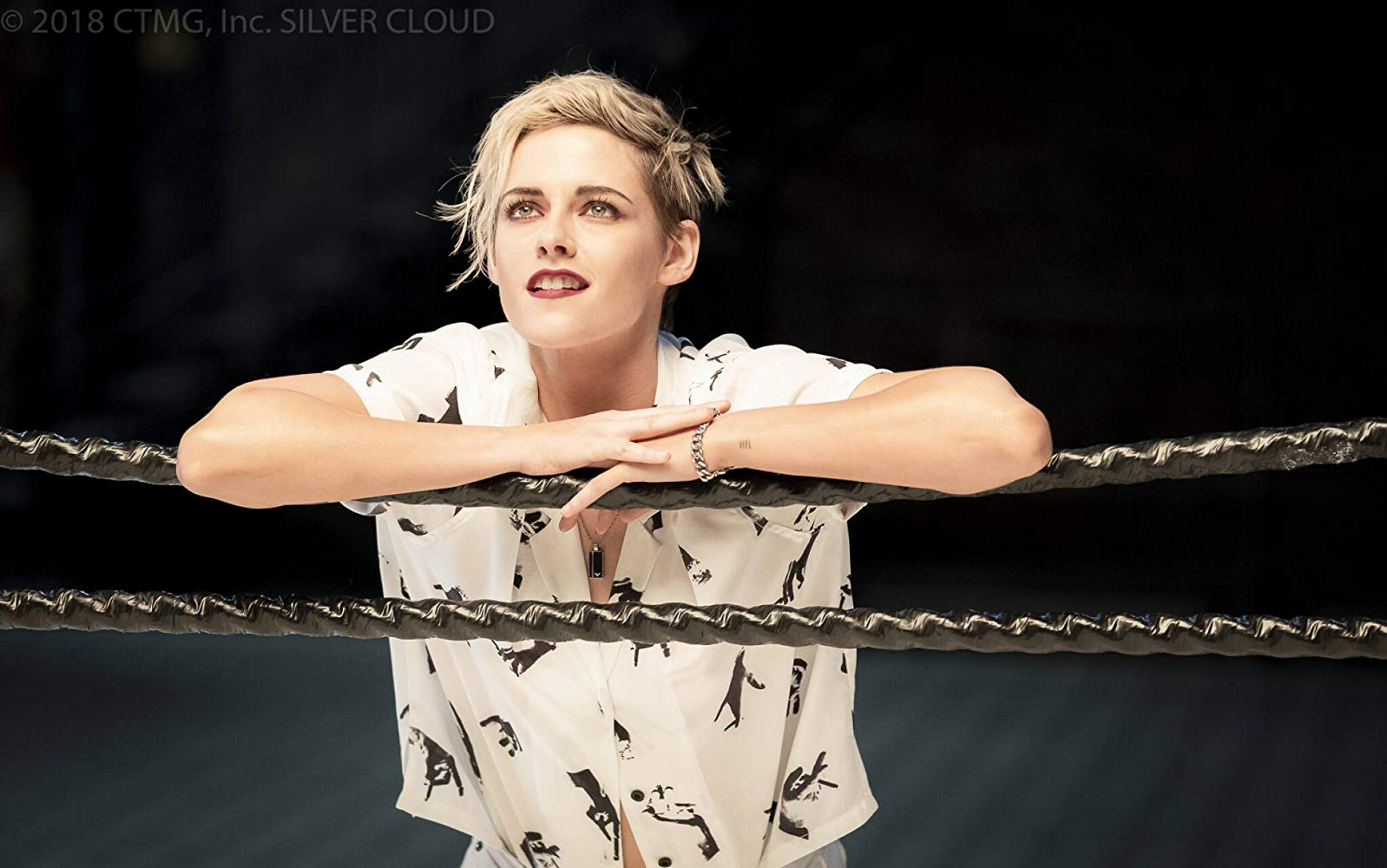 Kristen Stewart as Sabina in Charlie's Angels leans against the ropes of a boxing ring.
