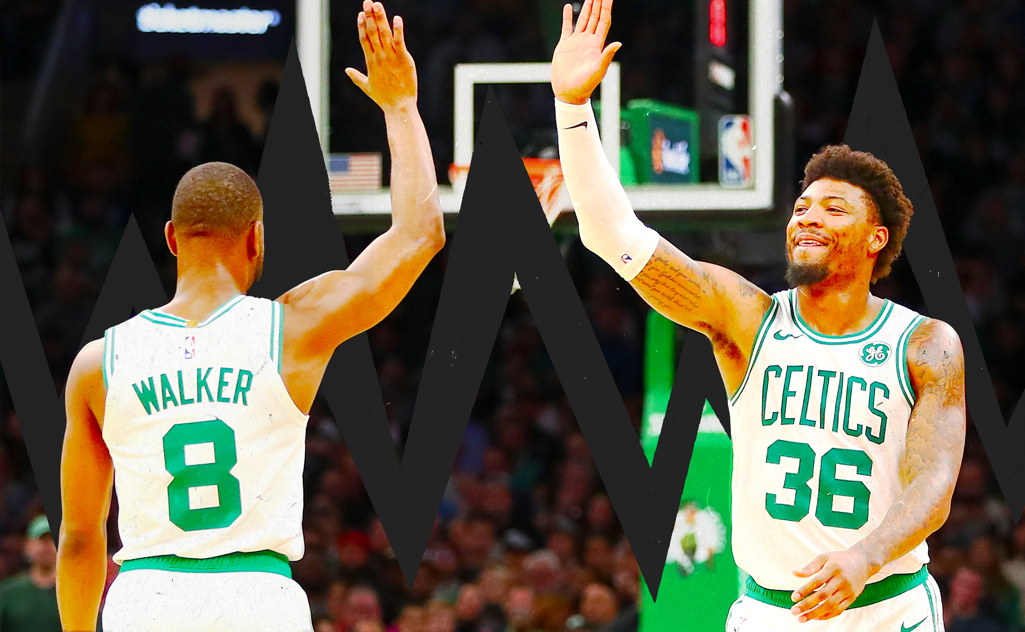 Marcus Smart and Kemba Walker exchange a high-five during the Celtics game.